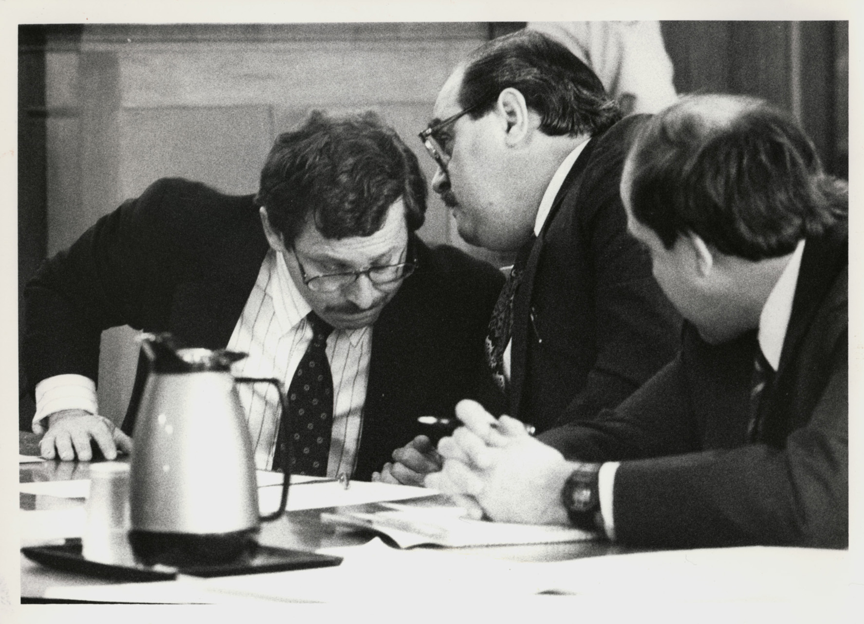 Bobo Marrapese, center, confers with lawyer Richard Egbert, left, while another of his lawyers listens in. Courtesy of the Providence Journal/Lawrence S. Millard .