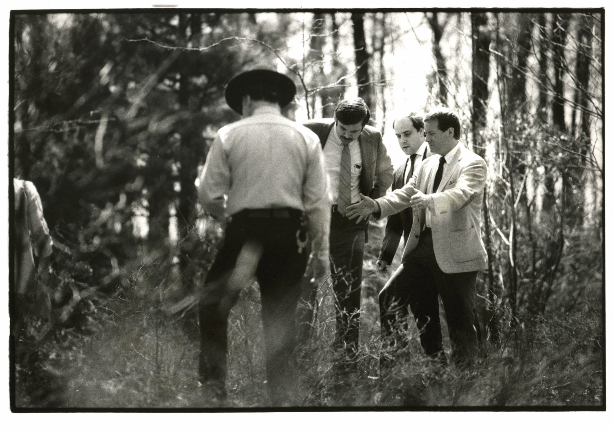 Rhode Island Assistant Attorney General Michael Burns, right, gestures over a hole in Rehoboth, Massachusetts,in 1986, where Dickie Callei was allegedly buried by Bobo Marrapese. Bobo was found guilty of that murder and sentenced to life in prison. At 74,Bobo is still serving time today. Courtesy of the Providence Journal/Mary Murphy .