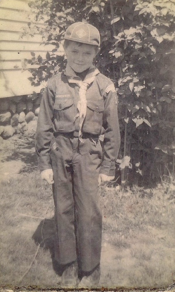 Charles poses in a Boy Scout uniform outside his family home. He began shoplifting at a very early age.