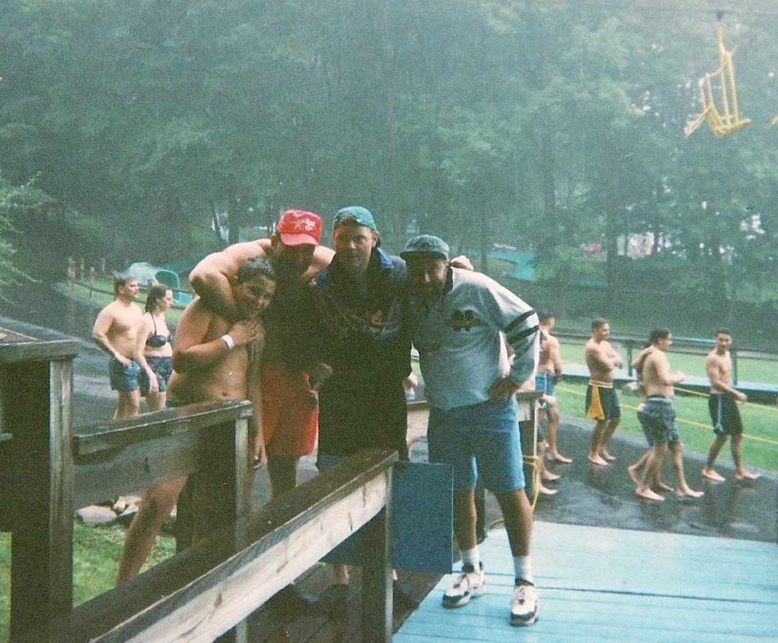 Big Al, second from left, poses next to Charles at a New York water park in the summer of 1994. At six foot two and 285 pounds, Big Al was Charles's chief enforcer.