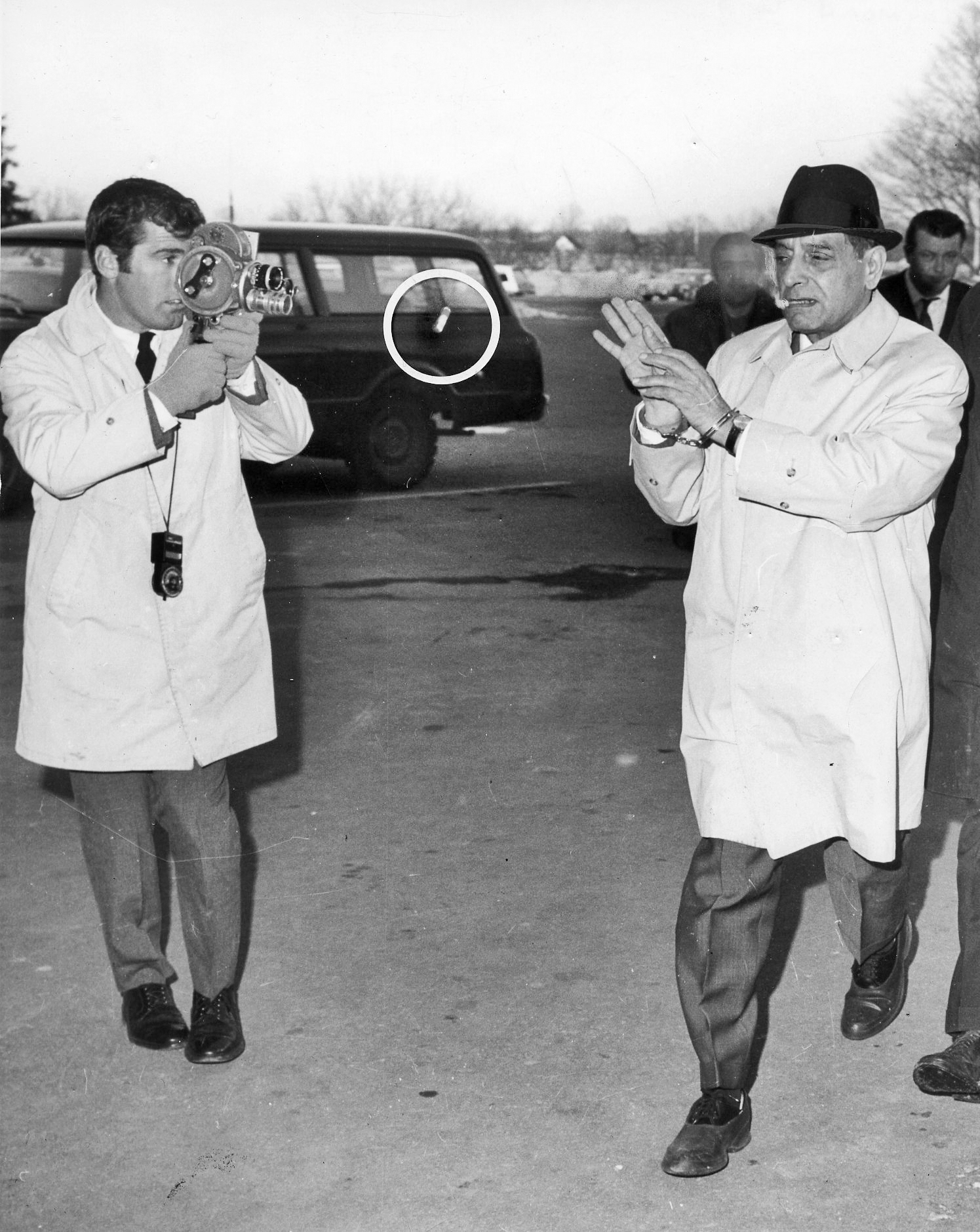 Patriarca flicks his cigar at a reporter as he enters state prison in 1969.  Courtesy of The Providence Journal.