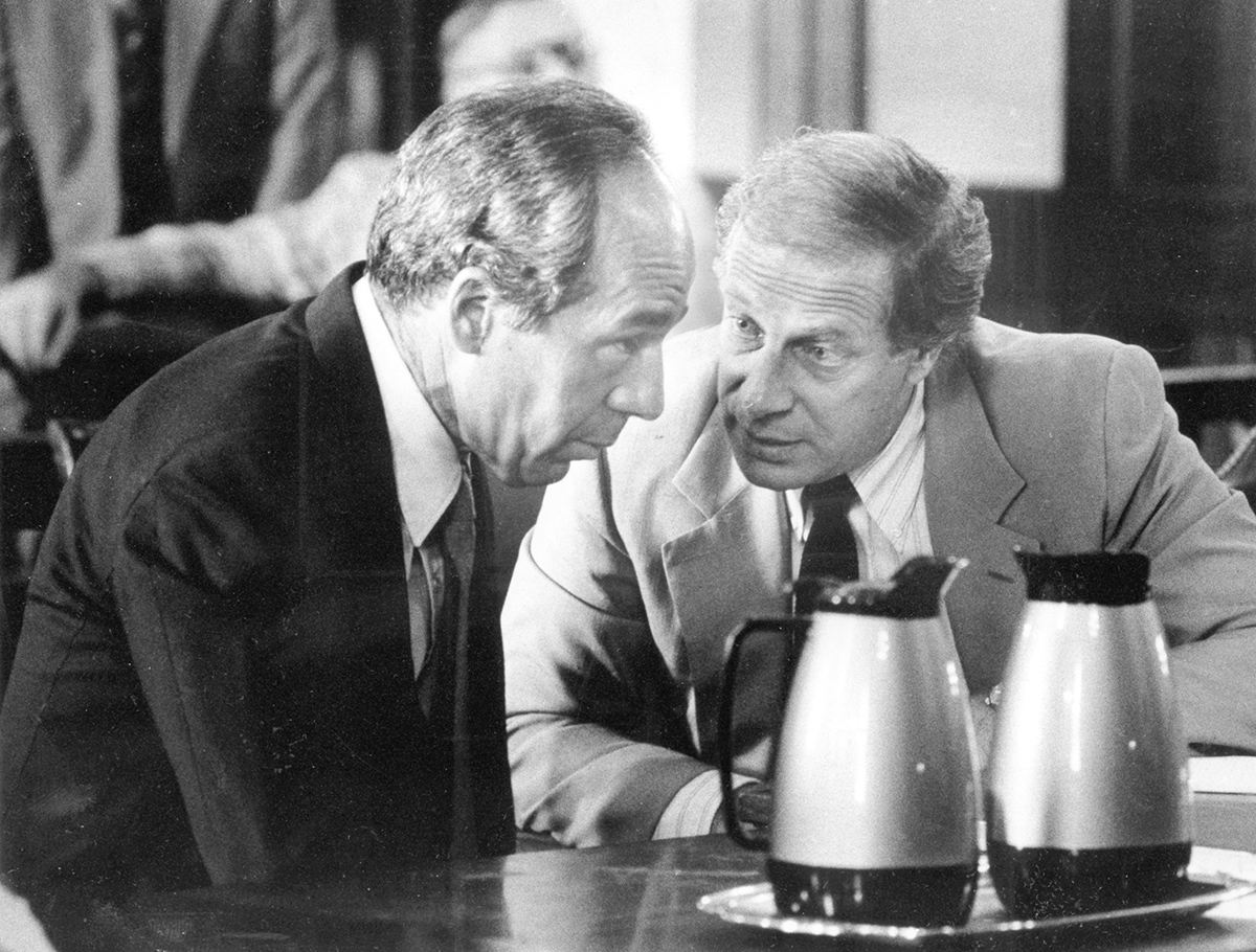 Manocchio listens to his attorney, Martin K. Leppo, before his sentencing in 1983.  Courtesy of The Providence Journal.
