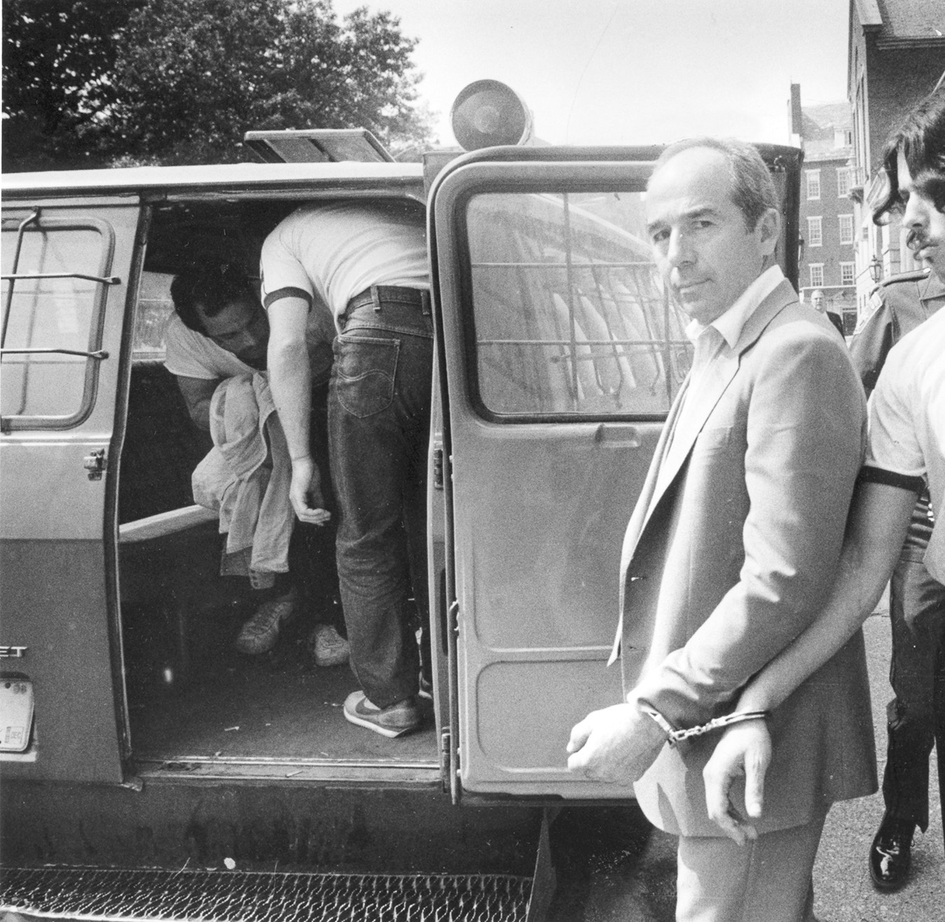 Manocchio is escorted from Superior Court in Providence, where he was found guilty on several counts in connection with the 1968 gangland slaying of Rudolph Marfeo and Anthony Melei.  Courtesy of The Providence Journal/Richard Benjamin.