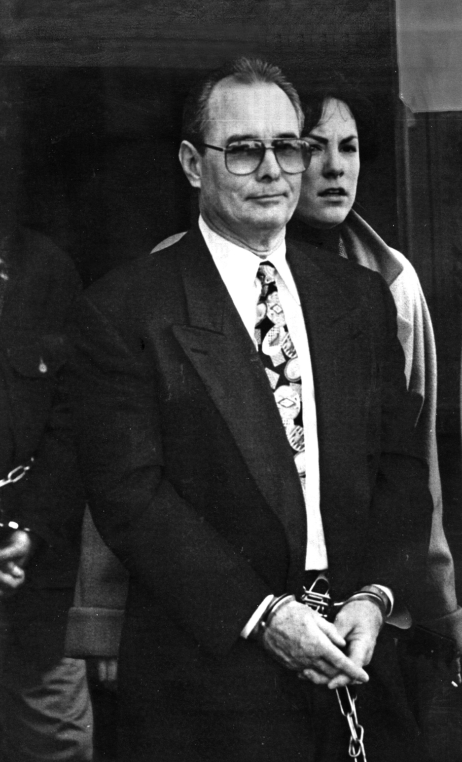 """Ouimette is escorted out of Federal Court after being sentenced to life in prison without parole on February 1, 1996. Ouimette was known for his flashy outfits and lifestyle;retired state police captain Brian Andrews described him as the """"Prince of Atwells Avenue."""" Courtesy of The Providence Journal/David Carson."""