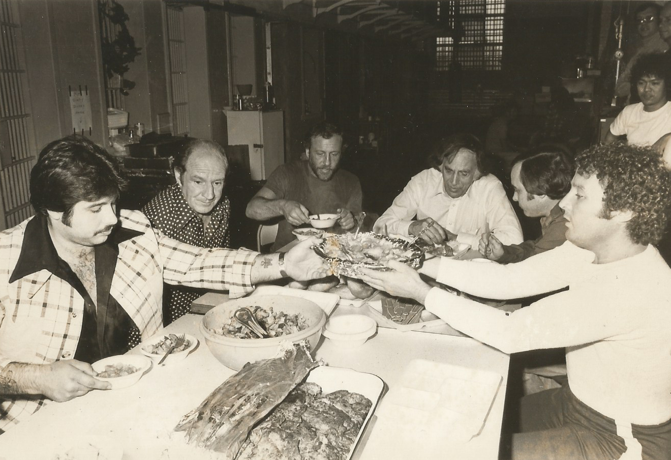 Ouimette, seated second from right, spent the 1970s in prison, but incarceration hardly slowed him down.He ran criminal enterprises from his cell, smuggled in alcohol, and enjoyed lavish dinners like the one pictured above.  Courtesy of The Providence Journal.