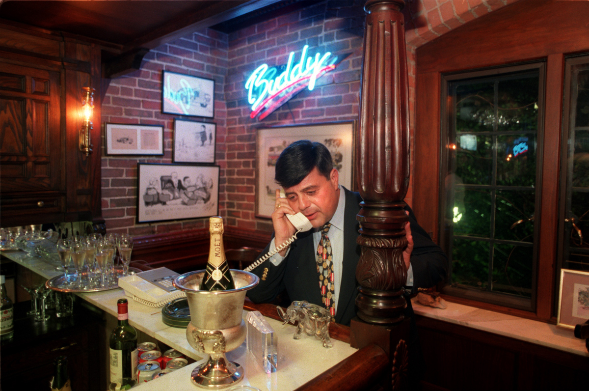 On election night in November 1994, Buddy Cianci takes a call at the bar in his home at 33 Power Street.  Courtesy of The Providence Journal/William K. Daby.
