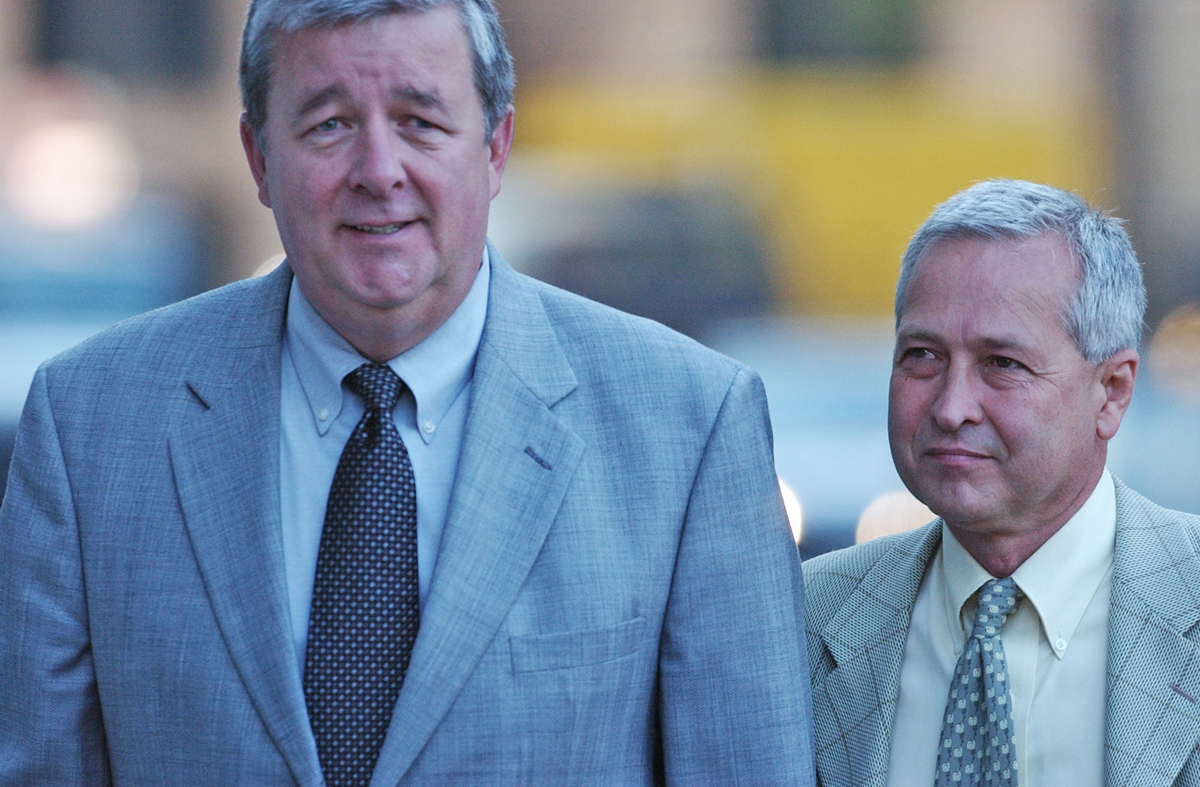 FBI Special Agent Dennis Aiken, left, arrives with cooperating witness and undercover operative Tony Freitas at U.S. District Court in Providence. Buddy was tried alongside his former director of administration, Frank Corrente, and businessman Richard Autiello.  Courtesy of The Providence Journal/Mary Murphy.
