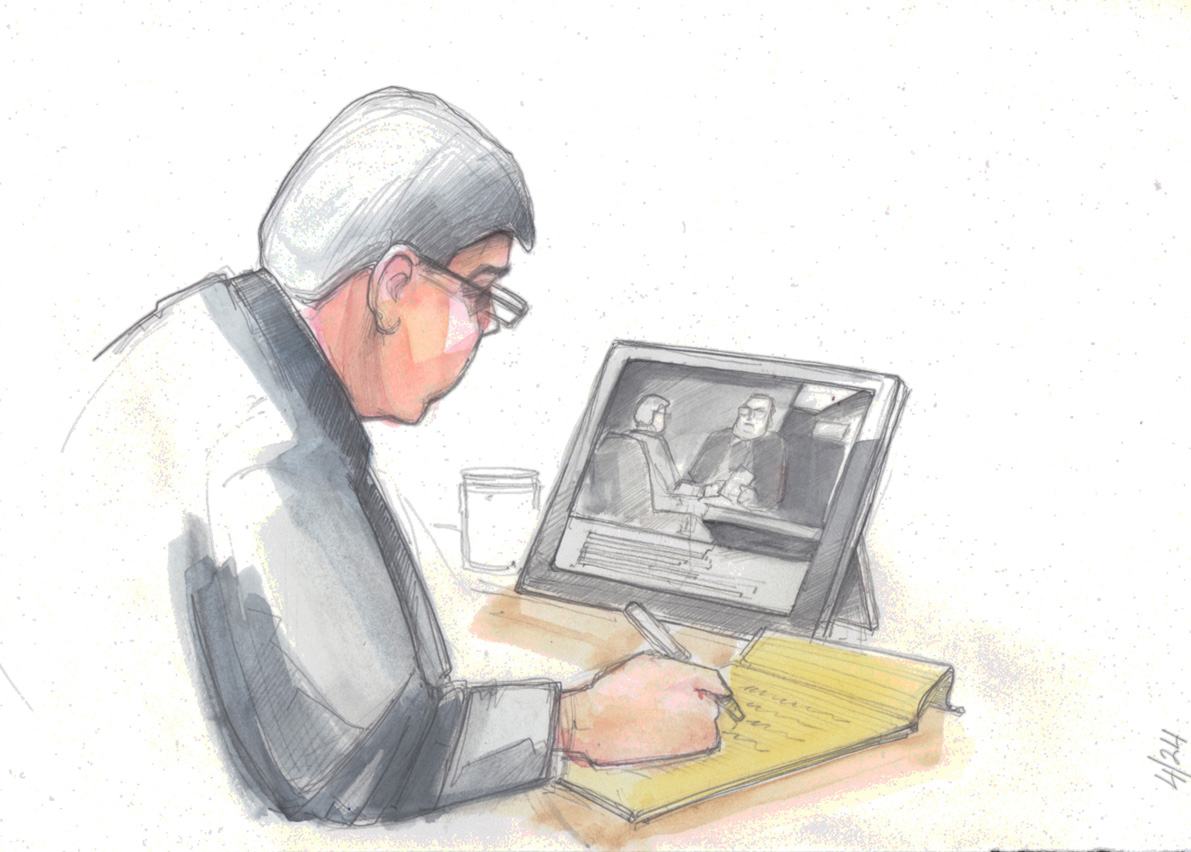 Buddy Cianci takes notes while watching hidden-camera video recorded by Tony Freitas. In the video, David Ead discusses how the flow of bribes made their way up to Buddy.  Courtesy of The Providence Journal/Frank Gerardi.