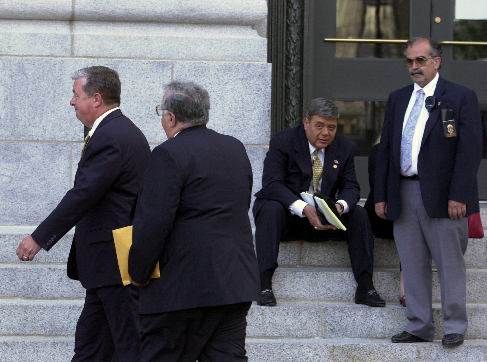 Buddy Cianci watches as Dennis Aiken, left, walks into U.S. District Court with David Ead. The former vice chairman of the Providence tax assessment review board, Ead struck a deal with investigators and agreed to be a witness for the prosecution.  Courtesy of The Providence Journal/Mary Murphy.