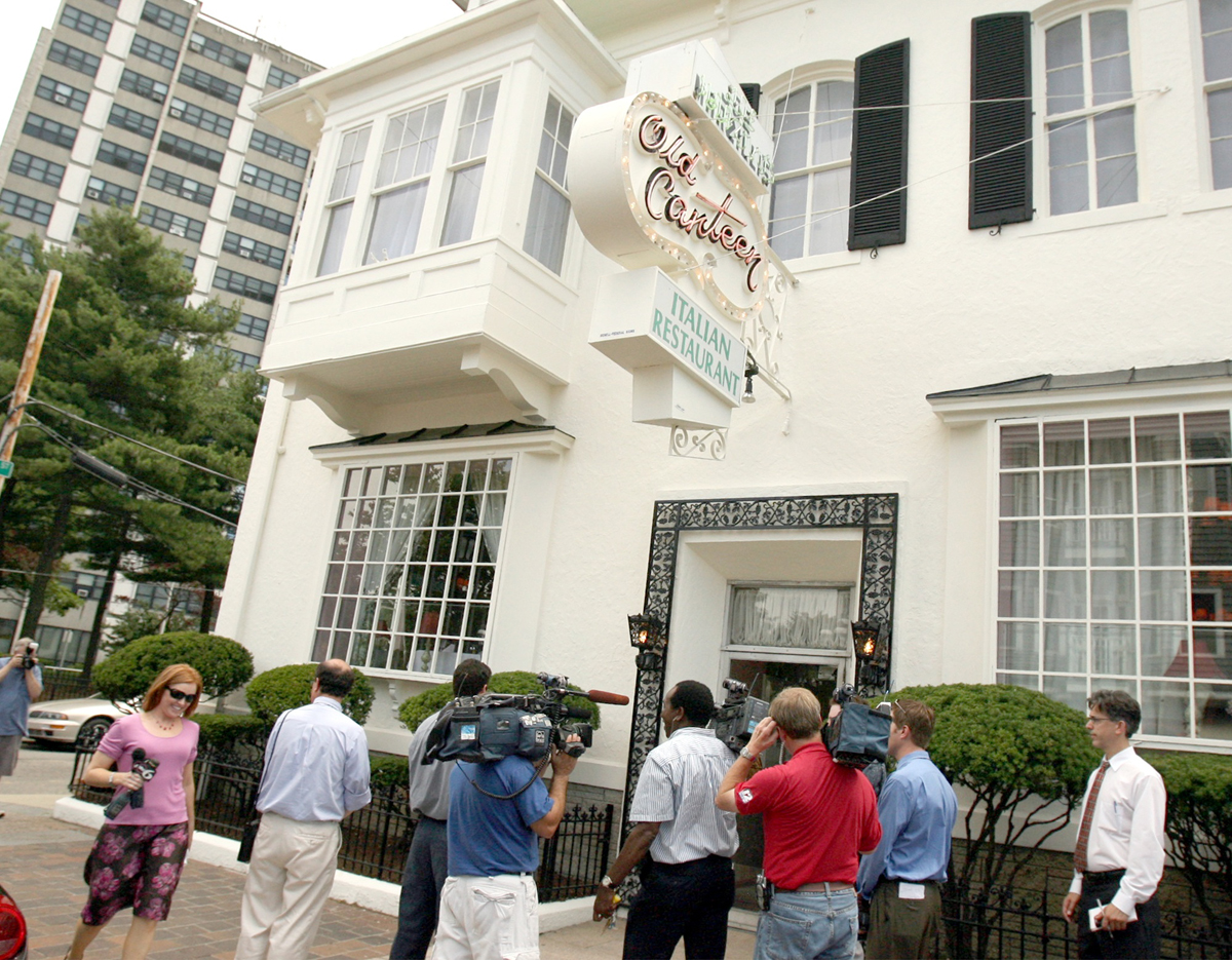 Reporters camp out in front of the Old Canteen restaurant on Atwells Avenue on July 27, 2007, waiting for former mayor Buddy Cianci to leave following lunch on his first official day of freedom. Buddy's electronic monitoring device was removed that morning.  Courtesy of The Providence Journal/Bill Murphy.