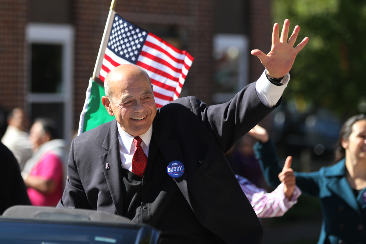 Buddy Cianci waves to the crowd during a parade on Atwells Avenue. In 2014, seven years after getting out of prison, he mounted his final campaign for mayor.  Courtesy of The Providence Journal/Glenn Osmundson.