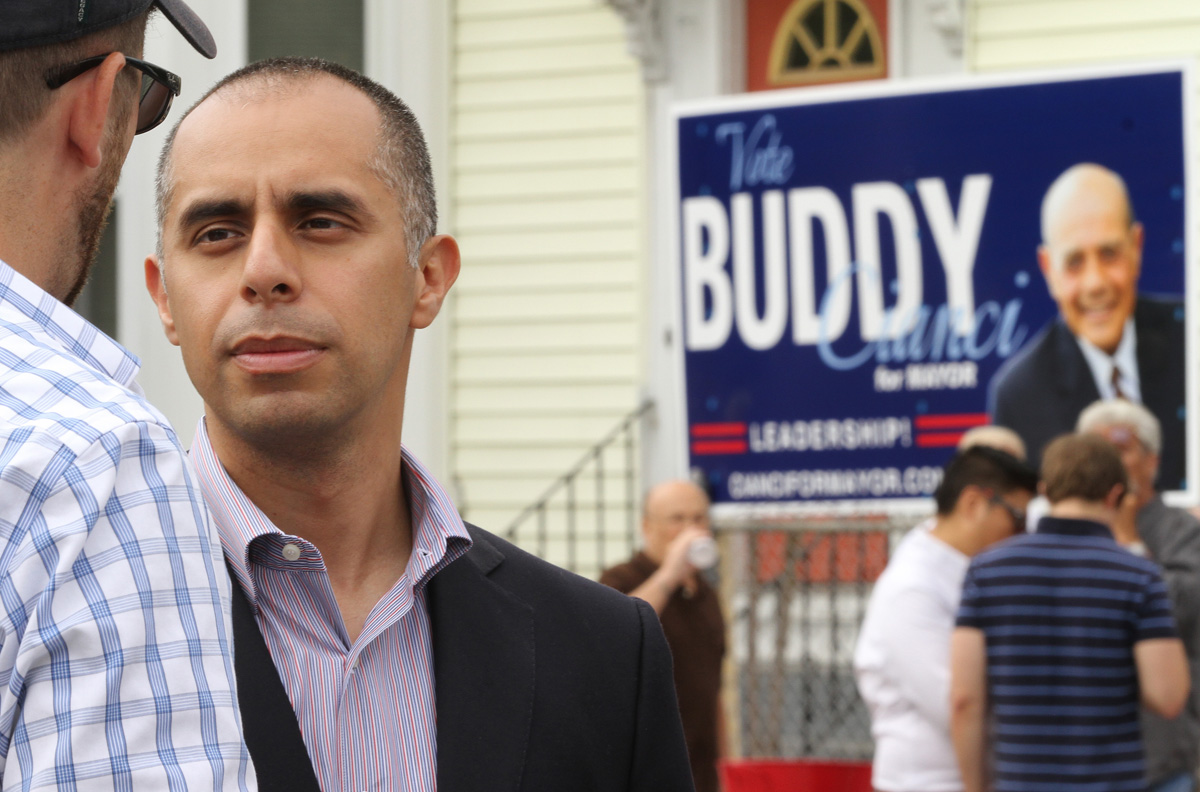 Democratic mayoral candidate and political newcomer Jorge Elorza talks with a friend at the West Broadway Neighborhood Association's Neighbor Day event in Providence.  Courtesy of The Providence Journal/Bob Breidenbach.