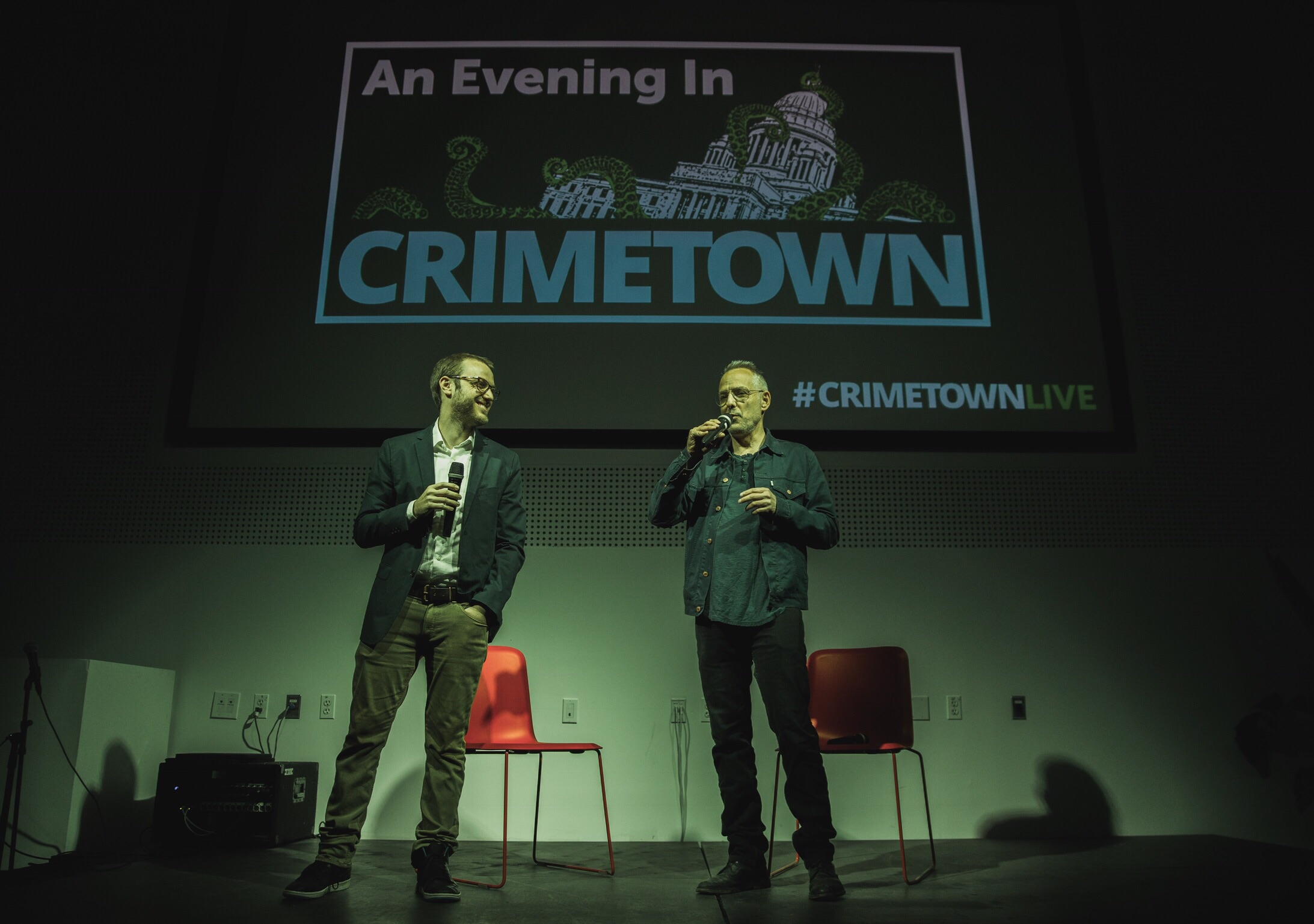 """On May 11, 2017, Crimetown co-hosts Zac Stuart-Pontier and Marc Smerling kicked things off at the live event in Brooklyn by introducing the master of ceremonies, journalist Dan Barry. When Marc and Zac began reporting in Providence, Barry """"was sort of our consigliere, our guru,"""" Marc said. Courtesy of  David Jacobson ."""