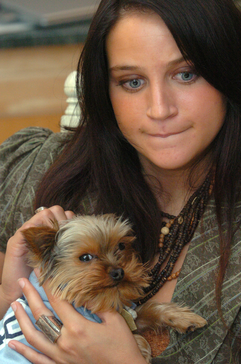 Courtney Calenda holds her Yorkshire Terrier, Oliver. The dog was a gift from lawyer Joseph Bevilacqua Jr. Calenda accused Bevilacqua of introducing her to cocaine and engaging in a sexual relationship that began when she was 17 and he was 53.  Courtesy of The Providence Journal/Bill Murphy.