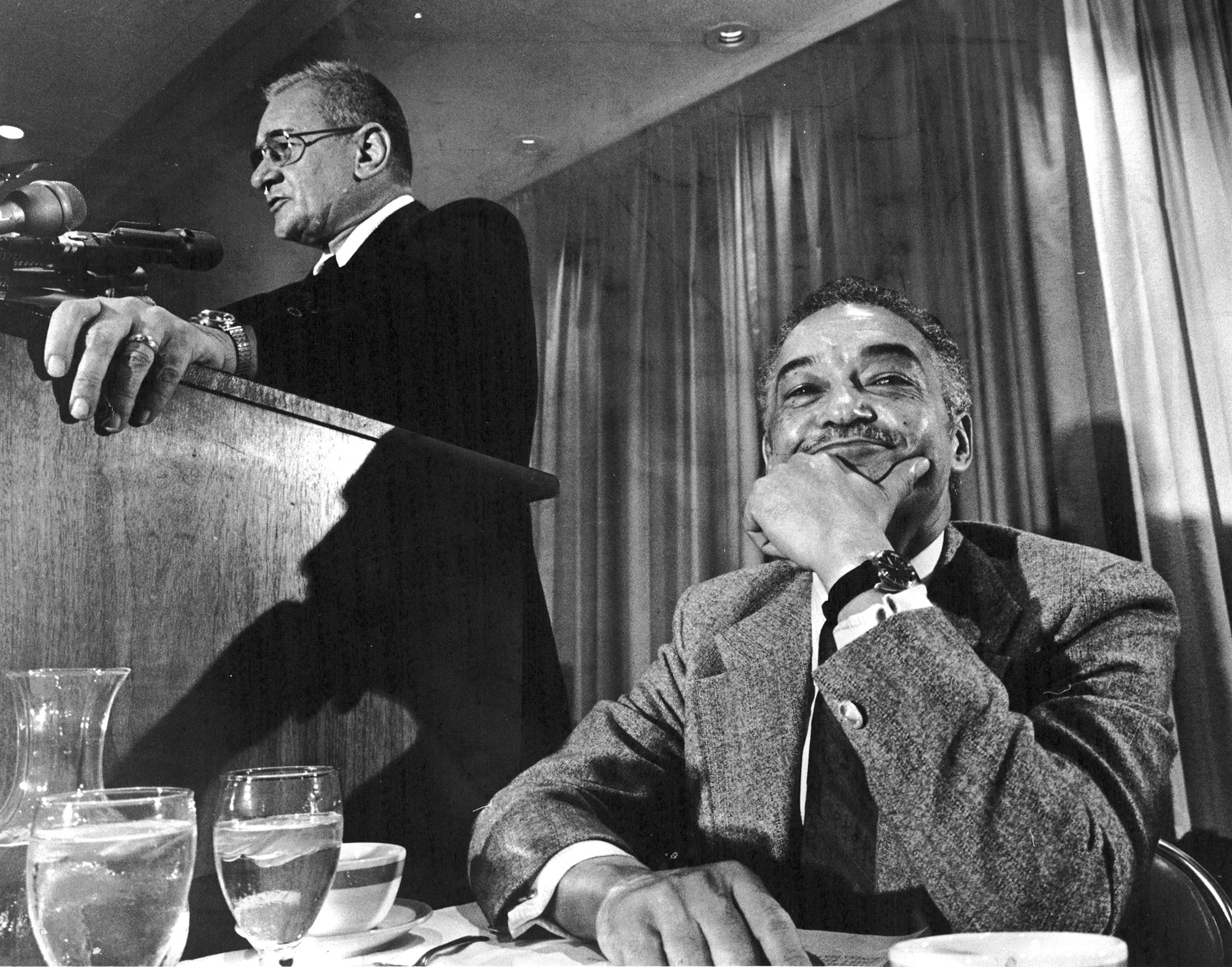 Mayoral candidate John Nichols speaks while Coleman Young, his opponent, waits his turn at the Detroit Economic Club luncheon in October 1973.  Courtesy of the Detroit Free Press .