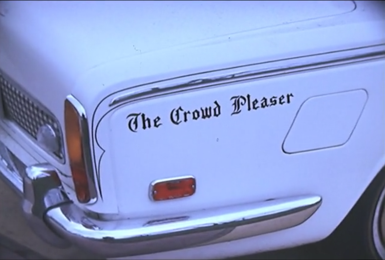 """Eddie Jackson and Courtney Brown both owned multiple luxury cars. Eddie customized his Cadillac with this """"Crowd Pleaser"""" decal. He would periodically drive the car through depressed areas of Detroit and throw money out of the window.  Courtesy of the Walter P. Reuther Library at Wayne State University."""