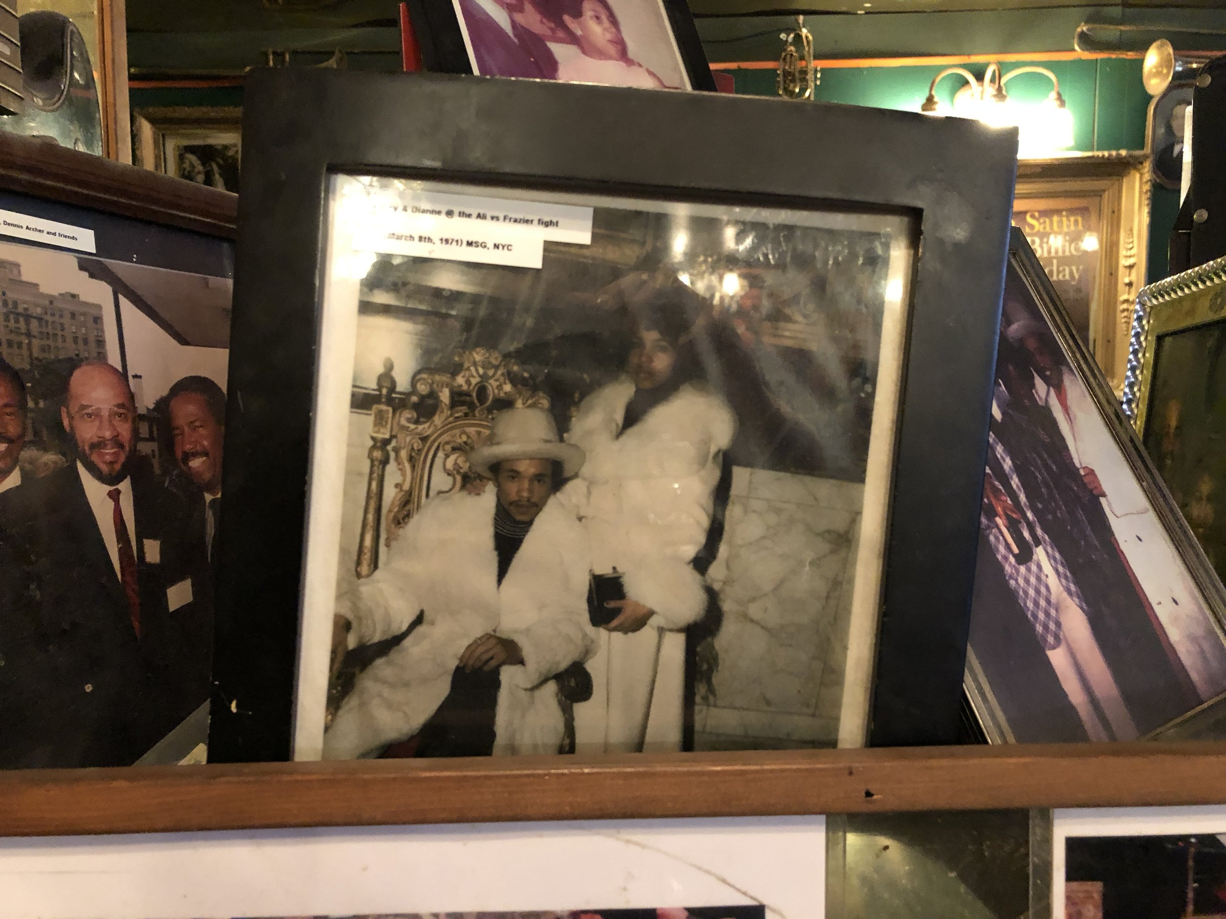 Cafe D'Mongo's is filled with old photos, like this shot of Larry and his wife Dianne wearing white mink furs at the 1971 Muhammad Ali-Joe Frasier fight in New York City — the same fight that heroin kingpin Eddie Jackson attended.  Photo by Drew Nelles.