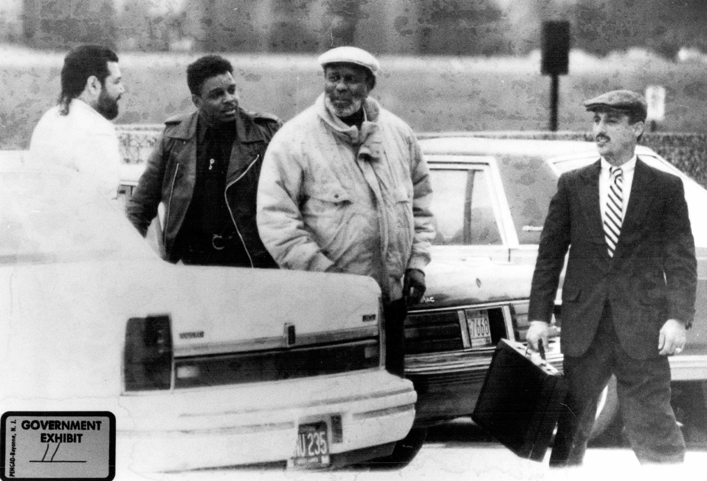 Posing as a drug dealer, FBI agent Mike Castro, far right, arrives at a Detroit-area bank. Royal Oak Township police officer Clarence Cooper, second from left, was allegedly recruited by Mayor Coleman Young's brother-in-law Willie Volsan, center.  Courtesy of the Detroit Free Press.