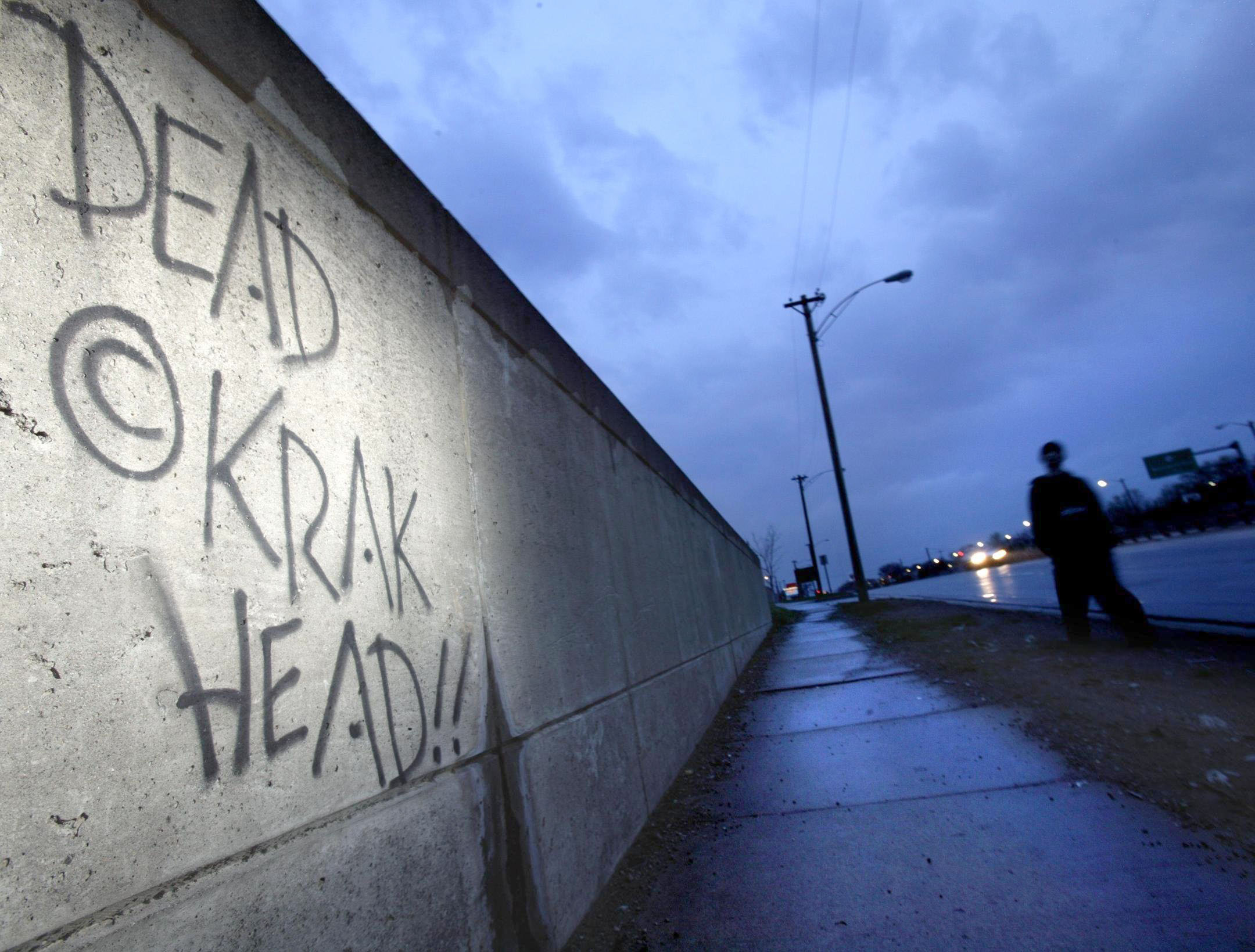 A graffiti epitaph to crack users on the wall of an underpass along 8 Mile Road, near the Michigan State Fair Grounds.  Courtesy of the Detroit Free Press.
