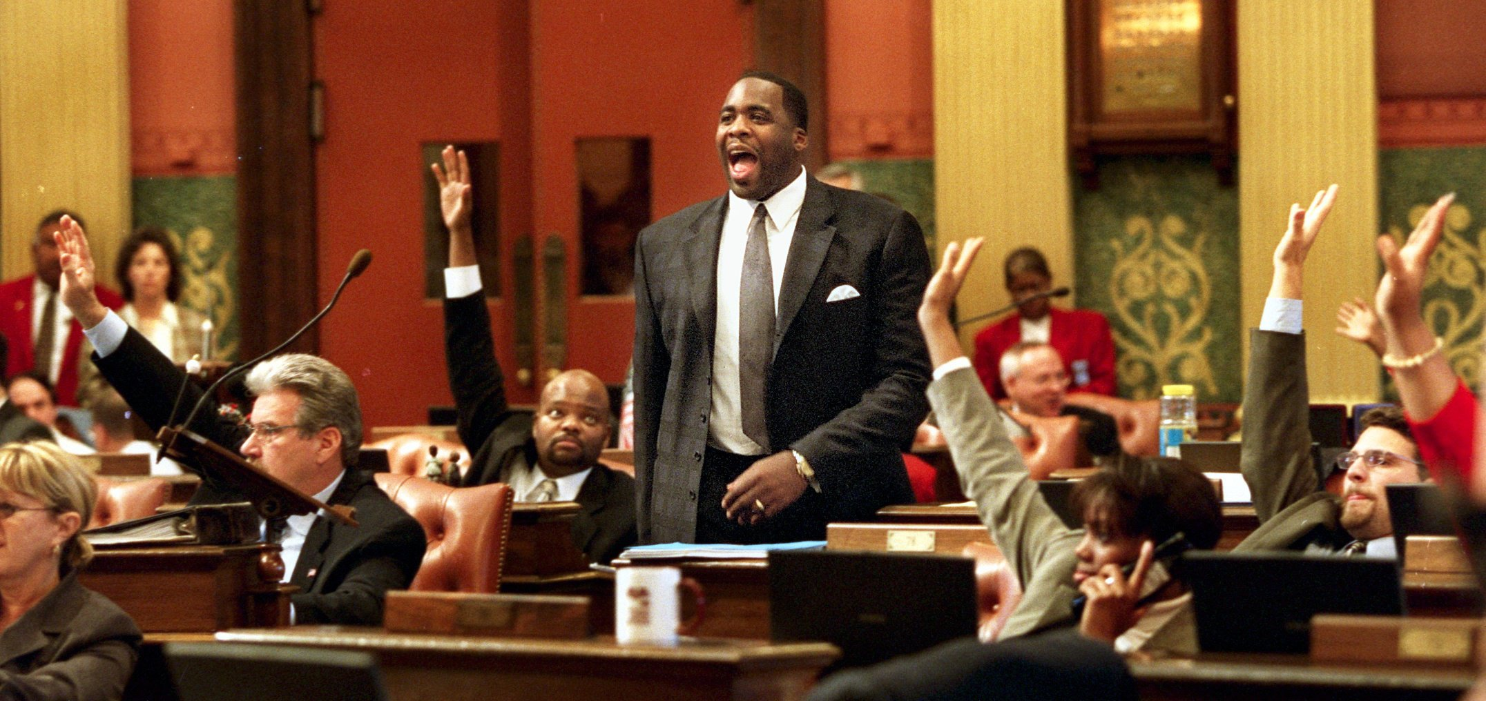 """Kwame screams """"Aye"""" during the passage of a bill at the Capitol in Lansing, October 24, 2001.  Courtesy of the Detroit Free Press."""