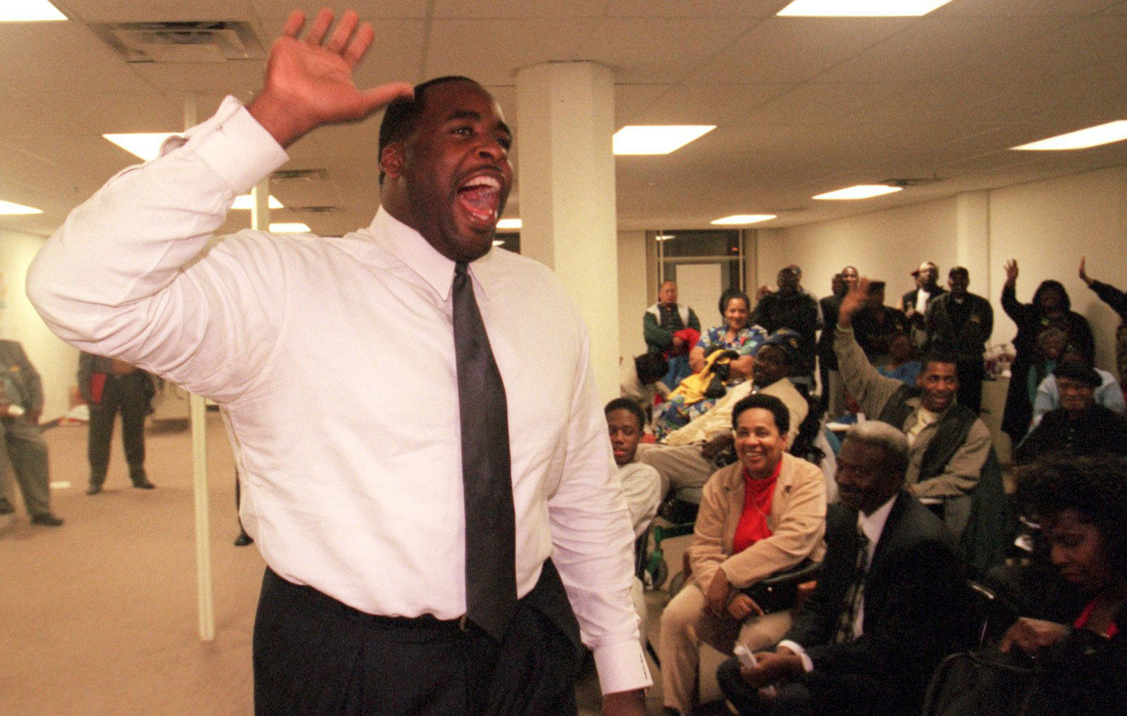 Detroit mayoral candidate Kwame Kilpatrick tries to rally campaign workers after nearly 14 hours of campaigning on October 24, 2001.  Courtesy of the Detroit Free Press.