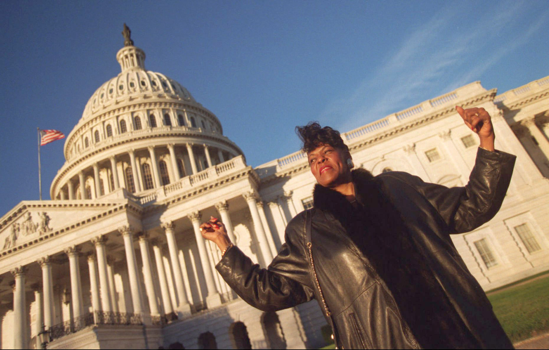 """Congresswoman Carolyn Cheeks Kilpatrick raises her arms in triumph on Jan. 6, 1997 on her way to work in Washington DC. """"This is it, this is my new office,"""" she exclaimed. """"We made it.""""  Courtesy of the Detroit Free Press."""