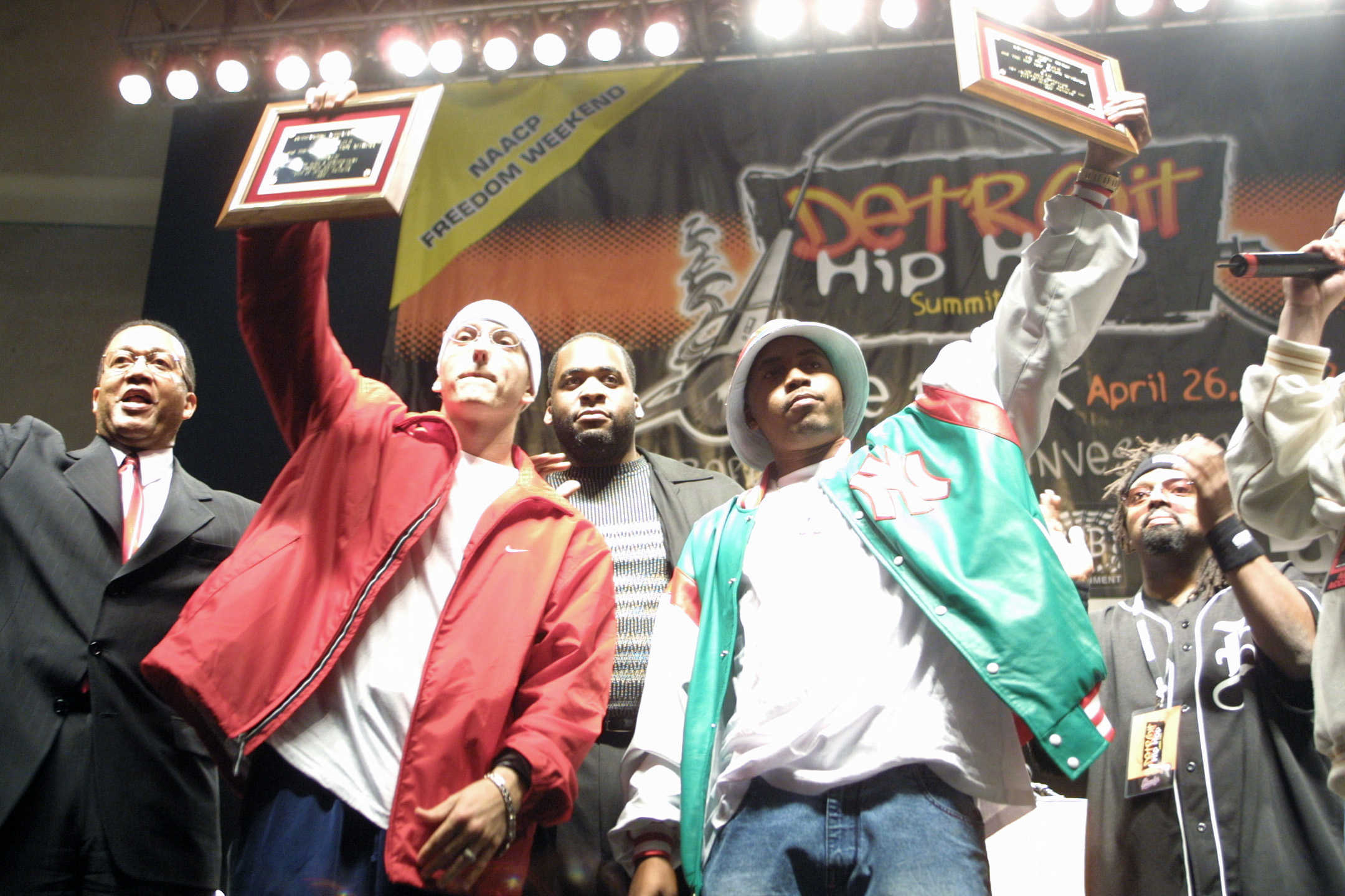 """Mayor Kwame Kilpatrick joins Eminem and Nas on stage at the 2003 Hip Hop Summit at Detroit's Cobo Arena. That weekend, Russell Simmons declared Kwame """"America's hip hop mayor,"""" a moniker that would become a source of both pride and trouble for the young mayor.  Courtesy of Tim and Tobias Smith."""