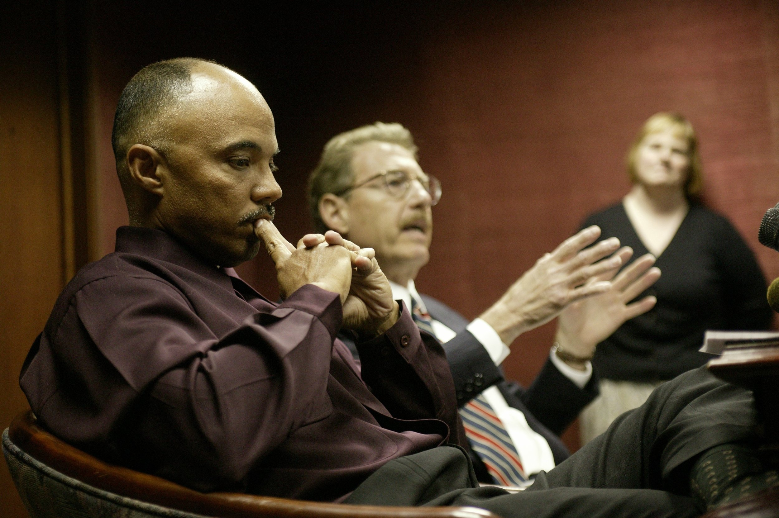 Former deputy police chief Gary Brown, left, during a press conference with his attorney. Mayor Kwame Kilpatrick fired Brown during a police investigation into rumors about a party at the Manoogian Mansion.  Courtesy of the Detroit Free Press.
