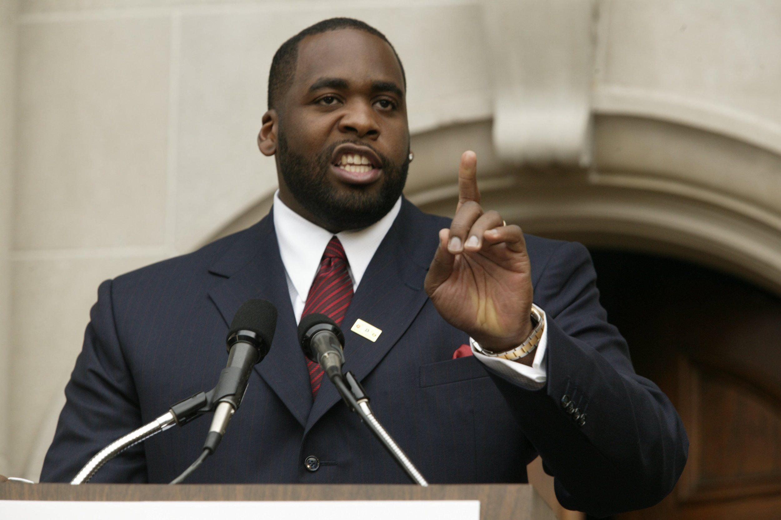 Detroit mayor Kwame Kilpatrick addresses the press in front of the Manoogian Mansion in 2003. During the press conference, Kilpatrick defended his recent firing of Gary Brown and denied having a party at the mayoral mansion.  Courtesy of the Detroit Free Press.
