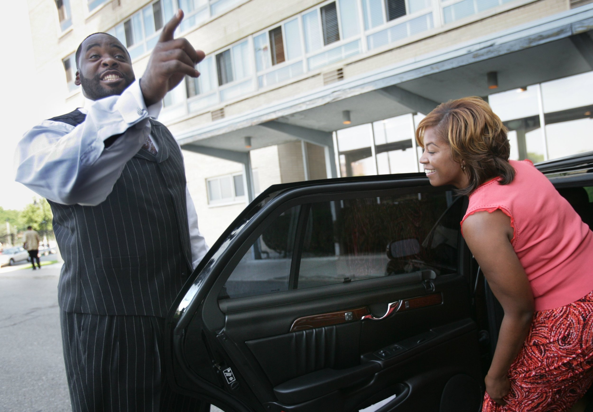 Kwame Kilpatrick jokes with the media after he and his wife Carlita voted in the 2005 Detroit mayoral primary. Detroit has an open primary system, so the top two vote-getters would run against each other in the November election.  Courtesy of the Detroit Free Press.