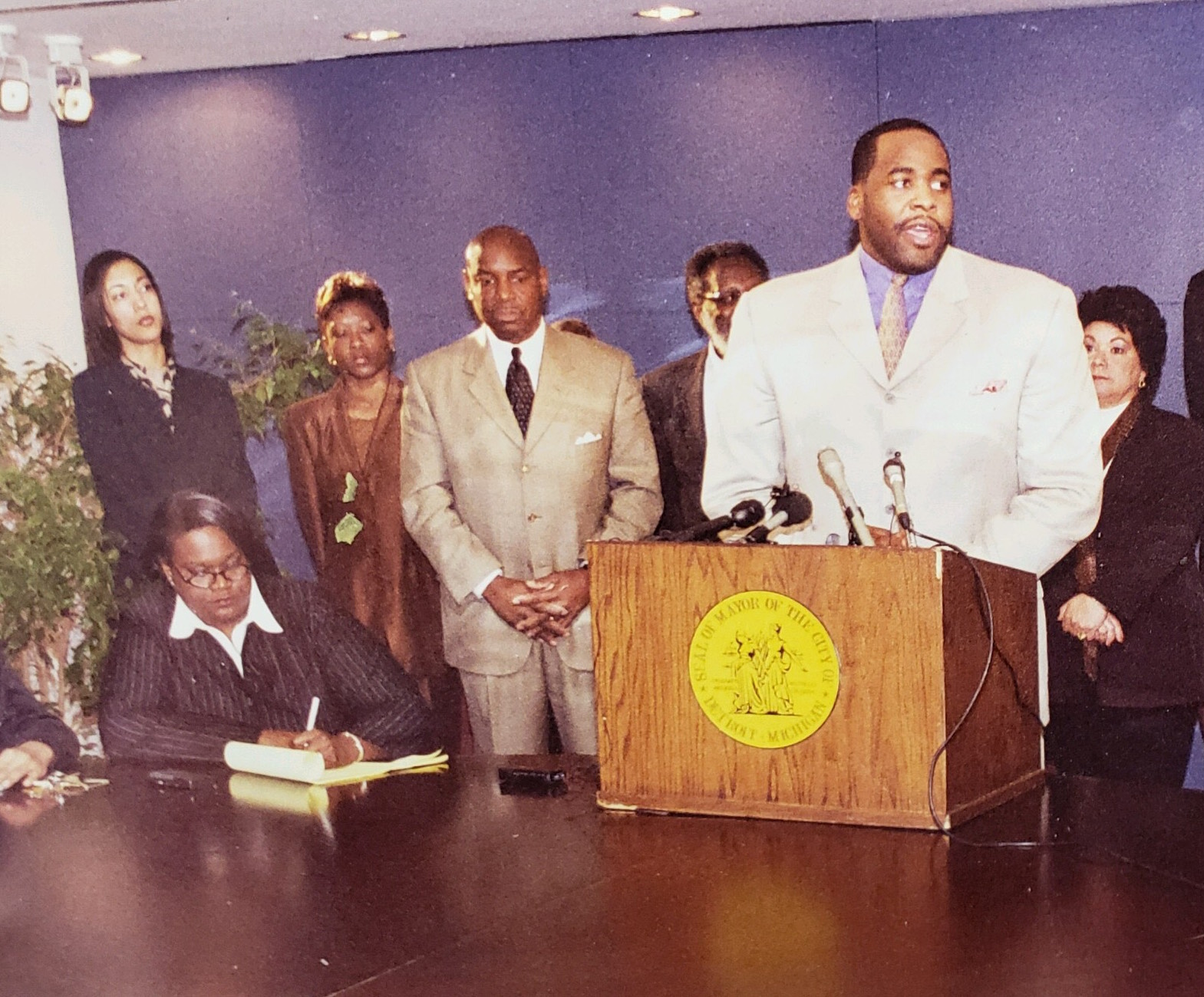 Mayor Kwame Kilpatrick at a press conference with Detroit Police Chief Jerry Oliver, center, and chief of staff Christine Beatty, left. When he became mayor in 2002, Kilpatrick broke with tradition to hire a police chief from out of town. Kilpatrick sought to reform the department, but his tenure as mayor was more often marked by controversy surrounding the police officers on his security staff.  Courtesy of Jerry Oliver.