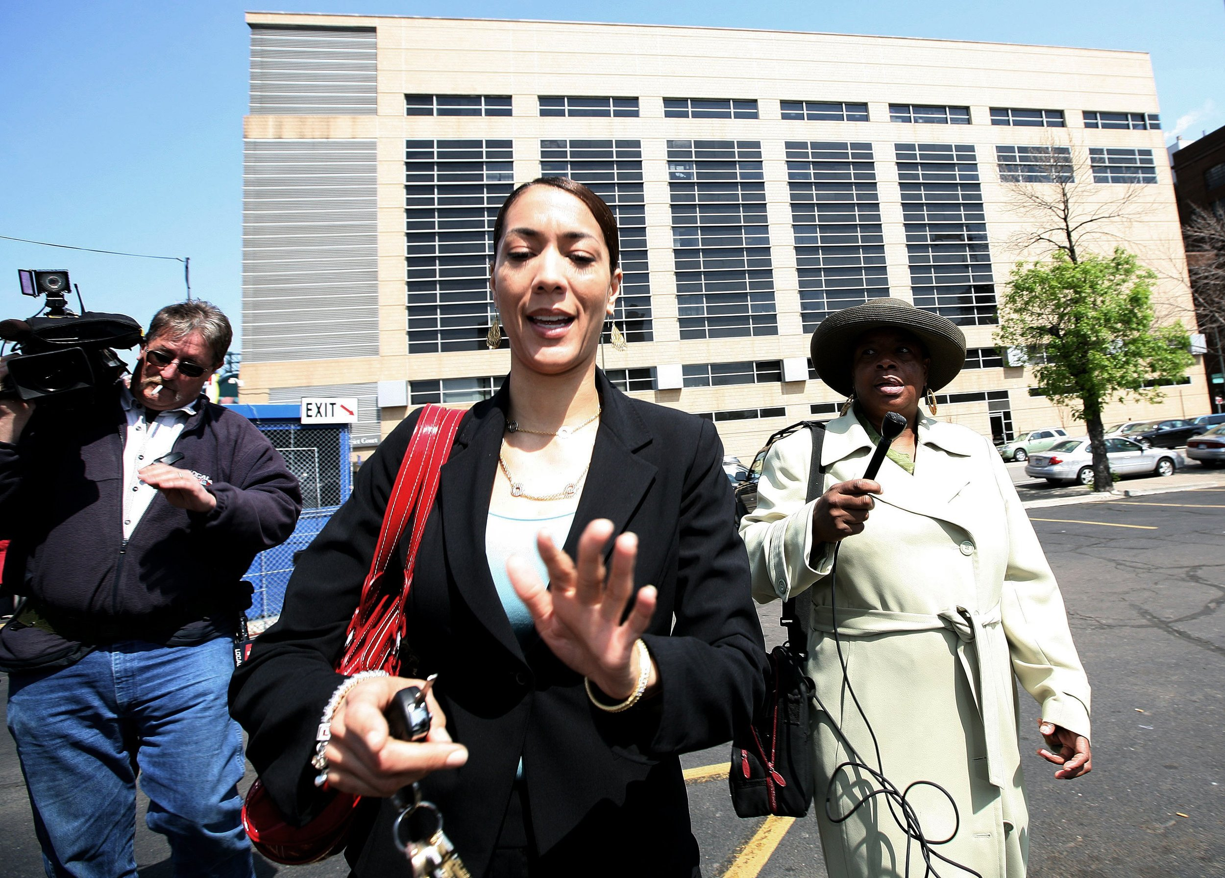 Christine is confronted by reporters while making her way from the 36th District Court in Detroit in May 2008. Lawyers representing Christine and Kwame were able to push back their preliminary hearing until September, which allowed Kwame to delay decisions about making a plea deal or resigning.  Courtesy of the Detroit Free Press.