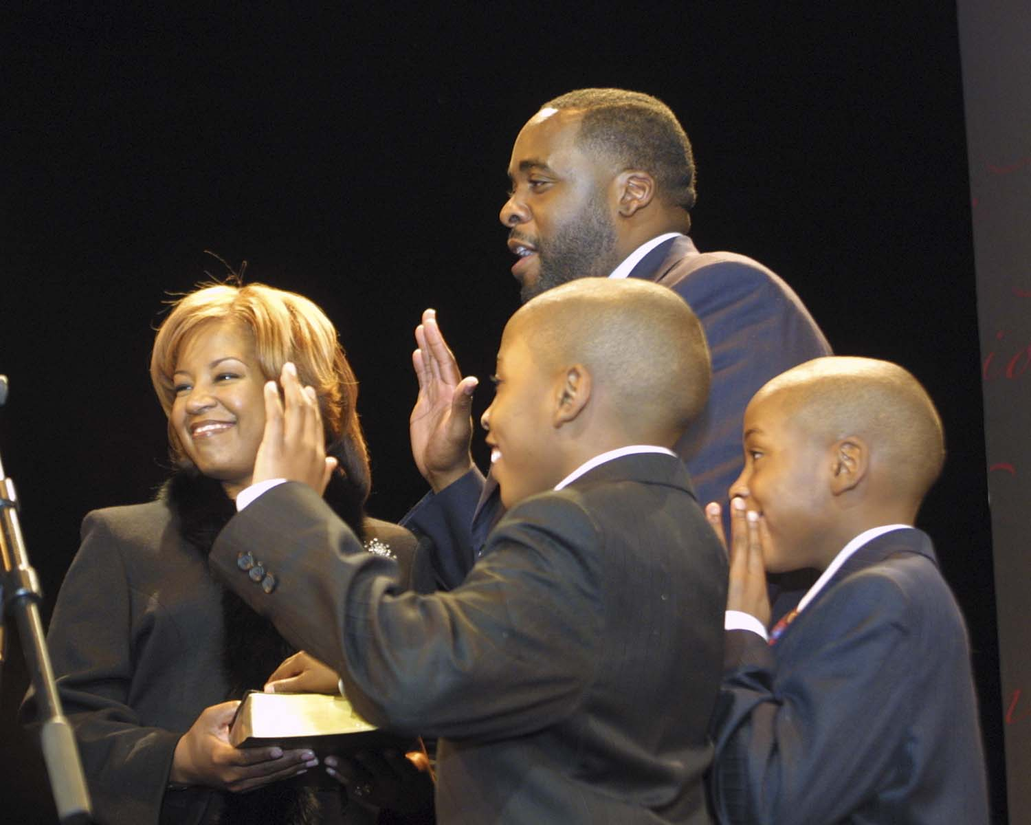 Kwame Kilpatrick with his wife Carlita and their twin sons Jelani and Jalil at Kwame's swearing-in ceremony during the 2006 inauguration. Kwame's relationship with Carlita grew strained due to his demanding schedule. But during the 2005 election, the couple decided to work on fixing their marriage, and Kwame says that broke off his affair with Christine.  Courtesy of Tim and Tobias Smith.