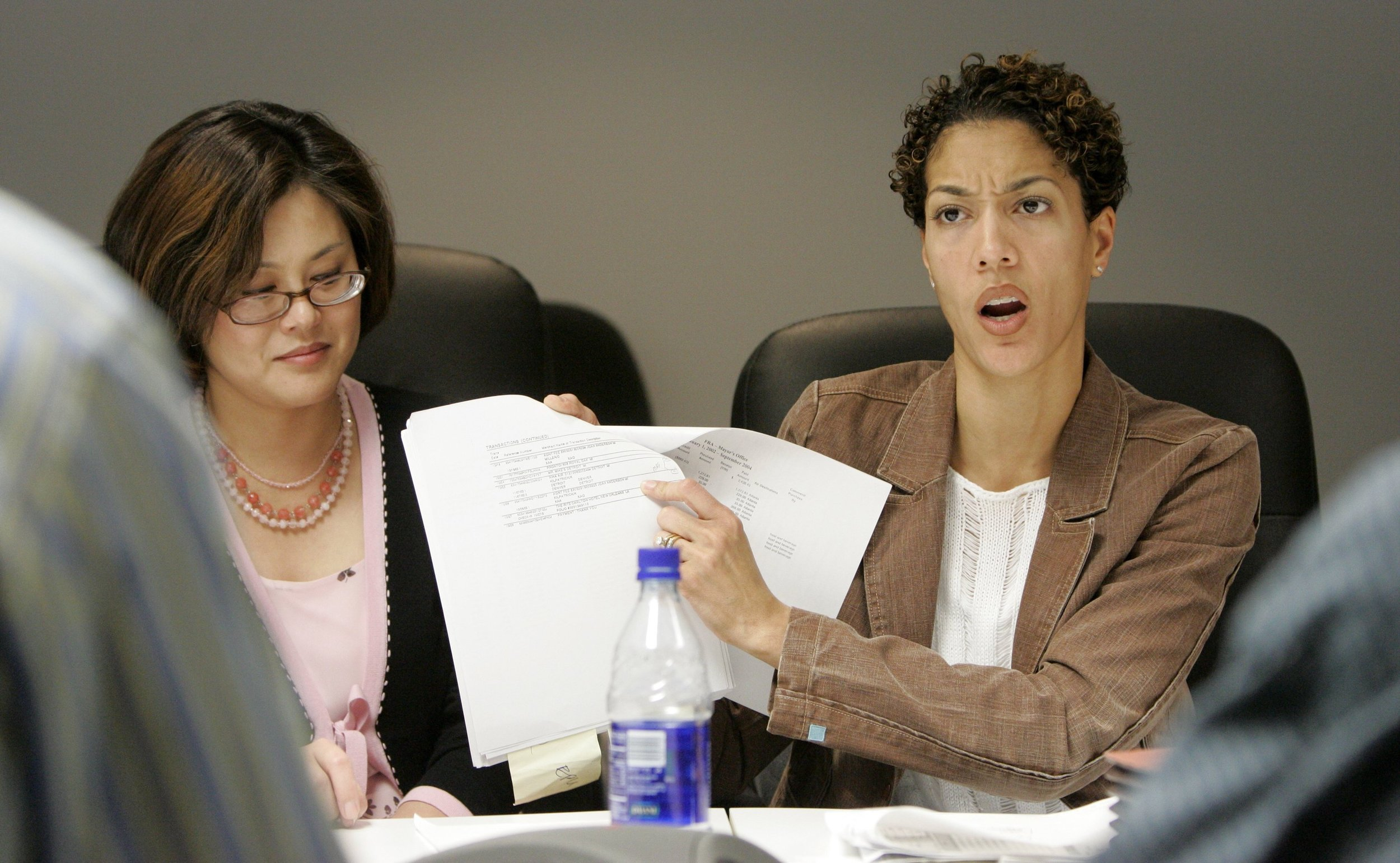 Christine talking to reporters in 2005. As chief of staff, Christine developed a reputation as a relentless defender of the mayor.  Courtesy of the Detroit Free Press.