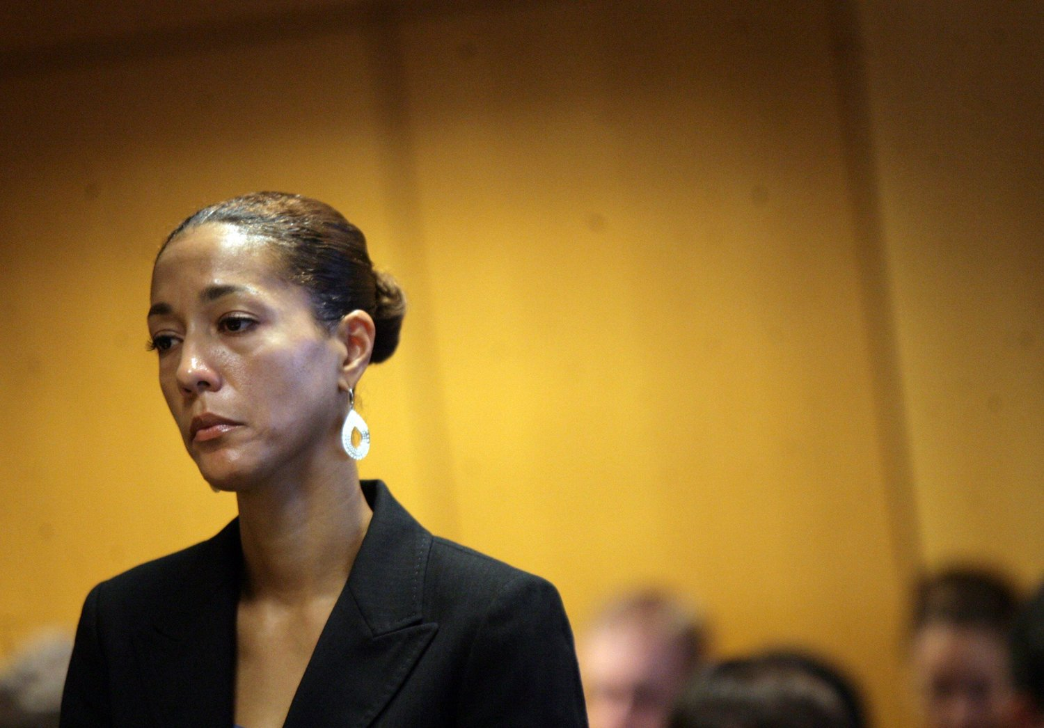 Christine Beatty listens as lawyers discuss Mayor Kwame Kilpatrick's guilty plea at the Frank Murphy Hall of Justice in September 2008. Christine and Kwame were charged with perjury and obstruction of justice in the Gary Brown whistleblower case.  Courtesy of the Detroit Free Press.