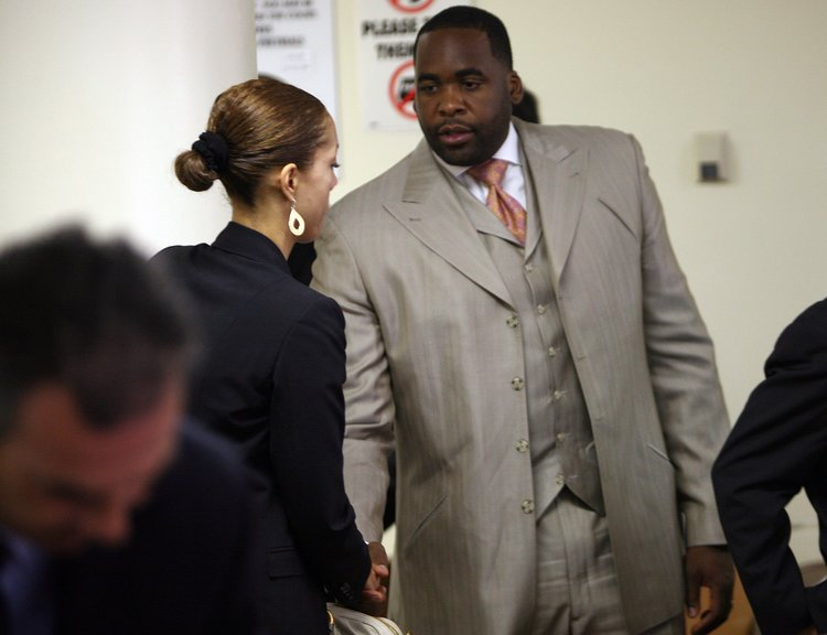 Christine shakes hands with Kwame in the 36th District Court in 2008.  Courtesy of the Detroit Free Press.