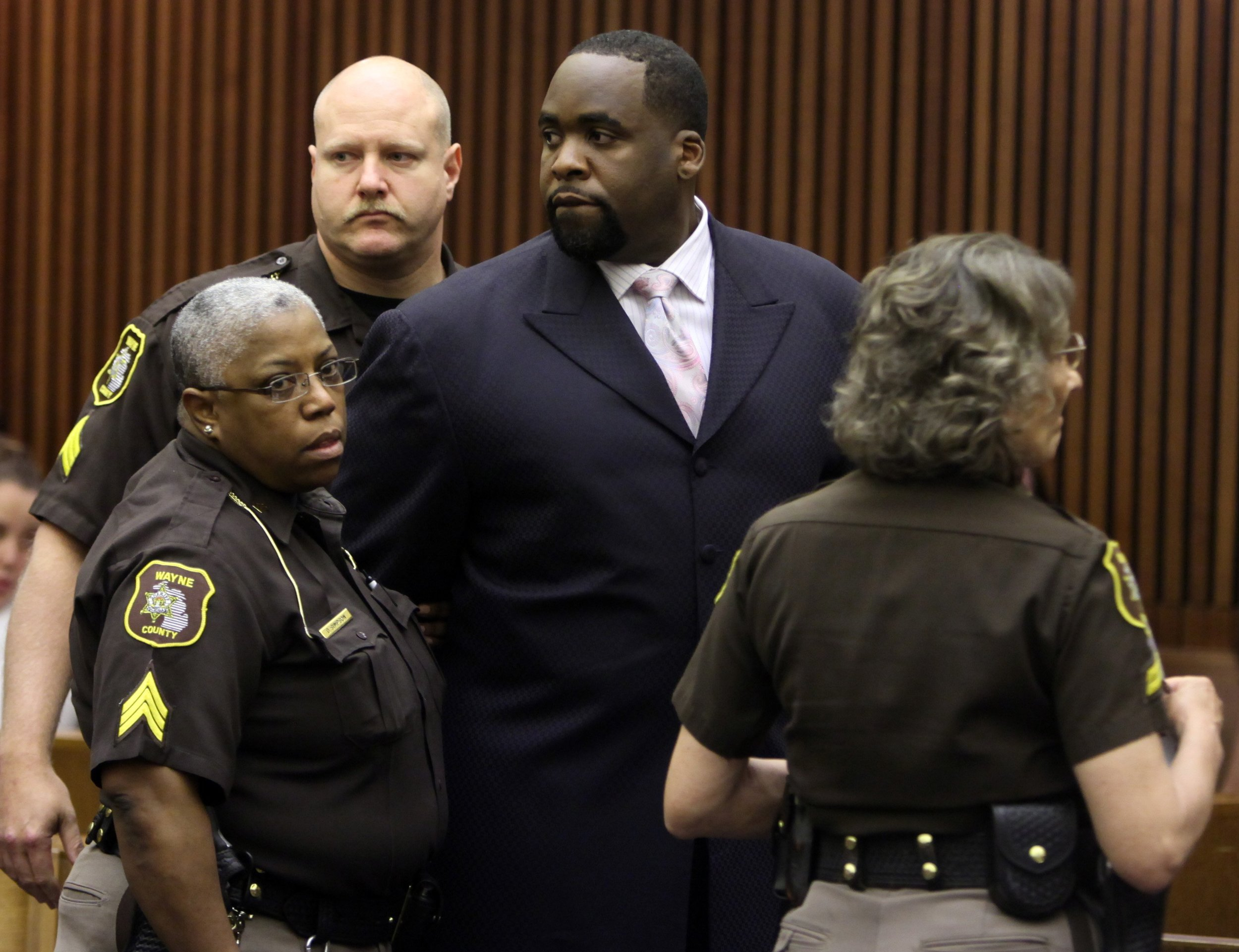 Kwame Kilpatrick served 99 days in jail for his 2008 perjury charges, but it wouldn't be his last time behind bars. Here, Kwame Kilpatrick is handcuffed after his sentencing by Judge David Groner in May 2010.  Courtesy of the Detroit Free Press.