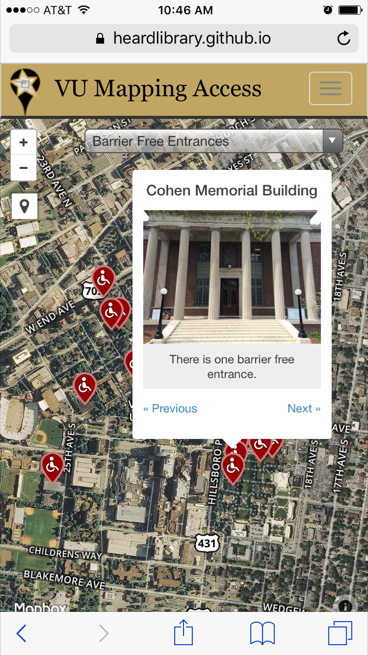 "[Image description: a screenshot of a campus accessibility map as viewed on a mobile screen. The map itself includes trees and buildings, as well as streets. Points of access (in this case, accessible entrances) are shown with red symbols with wheelchair access symbols on them. A pop-up shows Cohen Memorial Building with an image of the front (a brick building with columns and stairs) and a line of text that says ""There is one barrier free entrance.""]"