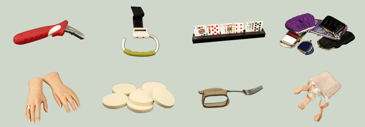 [Image description: Placed side by side are objects and tools modified and adapted for Cindy's ability and use. The top row, from left to right, has a red metal car assistance tool, an open ended carabineer attached to a black strap, a black rectangular card holder with playing cards, and a range of multicolored coin purses with clasps. On the bottom row from left to right are a pair of hyper realistic light-colored cosmetic hands, round cosmetic sponges, a fork attached to a leather loop for eating purposes, and 3-D printed fingers attached to a light-colored stretchy fabric.]