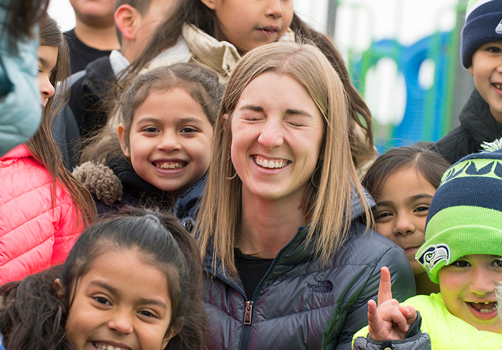 Camille Jones, 2017 Washington State Teacher of the Year. Smiling close-up with students.