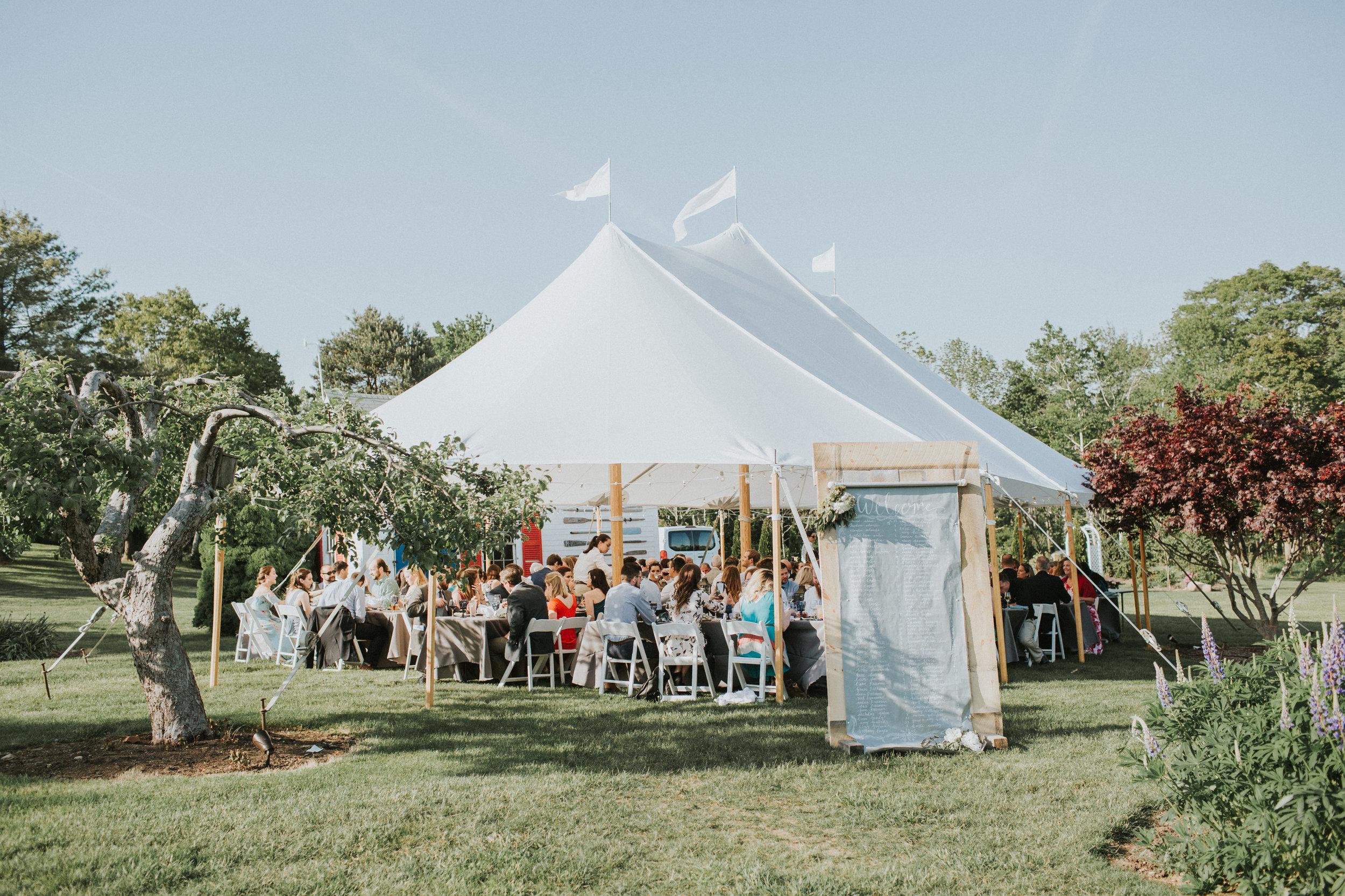 tented wedding reception apple orchard summer