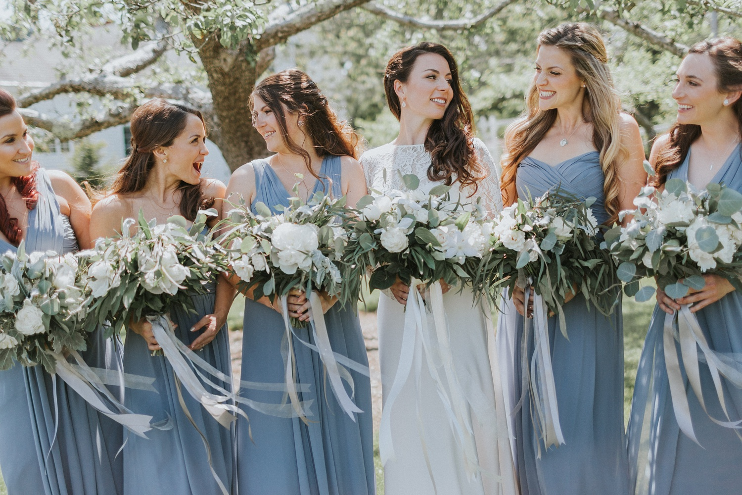 green white floral bouquets outdoor maine wedding