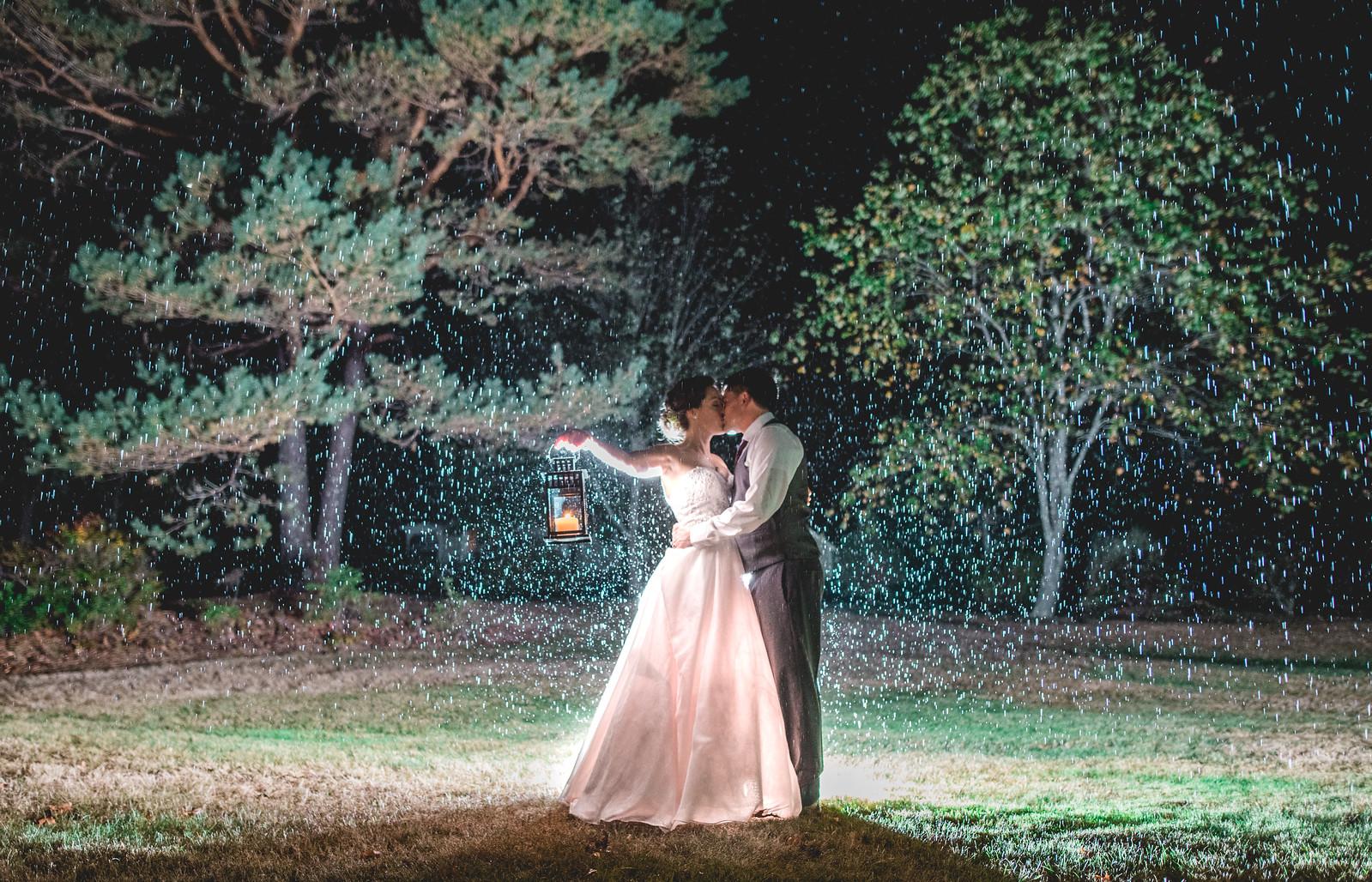 stunning kiss in the rain wedding photography