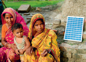 Family with a Solar Panel Created from an Impact Investment