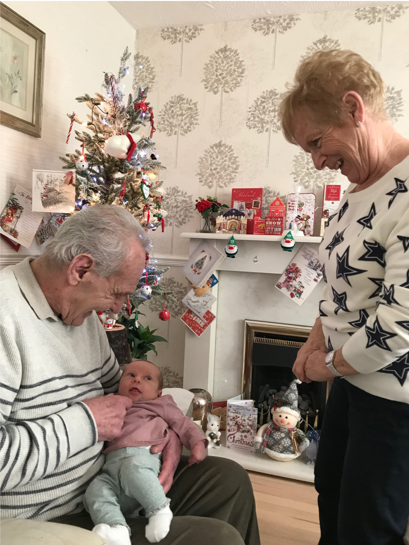 My grandfather (Archibald Reid), and grandmother (Margaret) meeting their great granddaughter, Adaline, a few weeks after her birth and a few weeks before Archie's death.