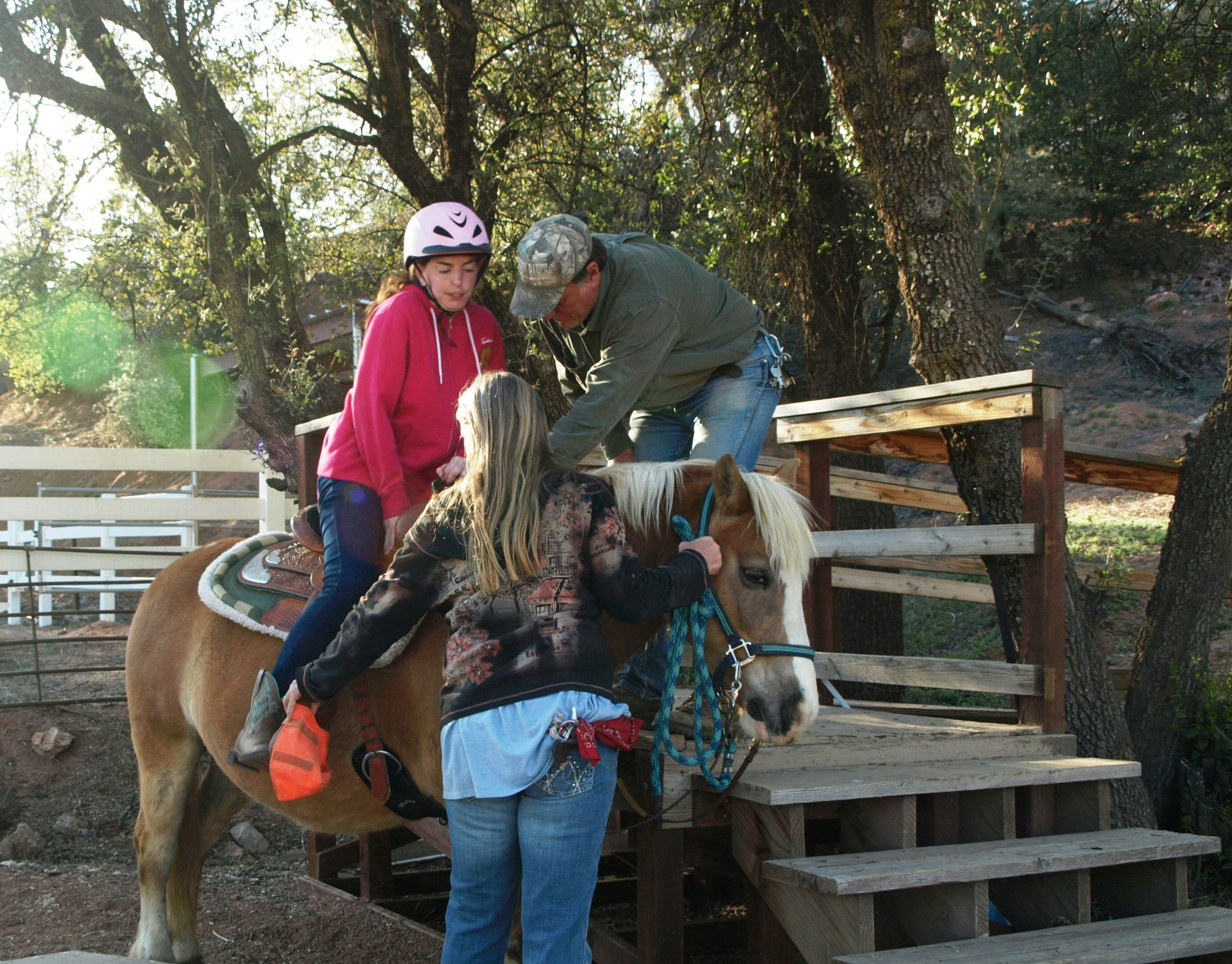 2.Becky mounting Autumn with with the help of Dennis and Kathy.jpg