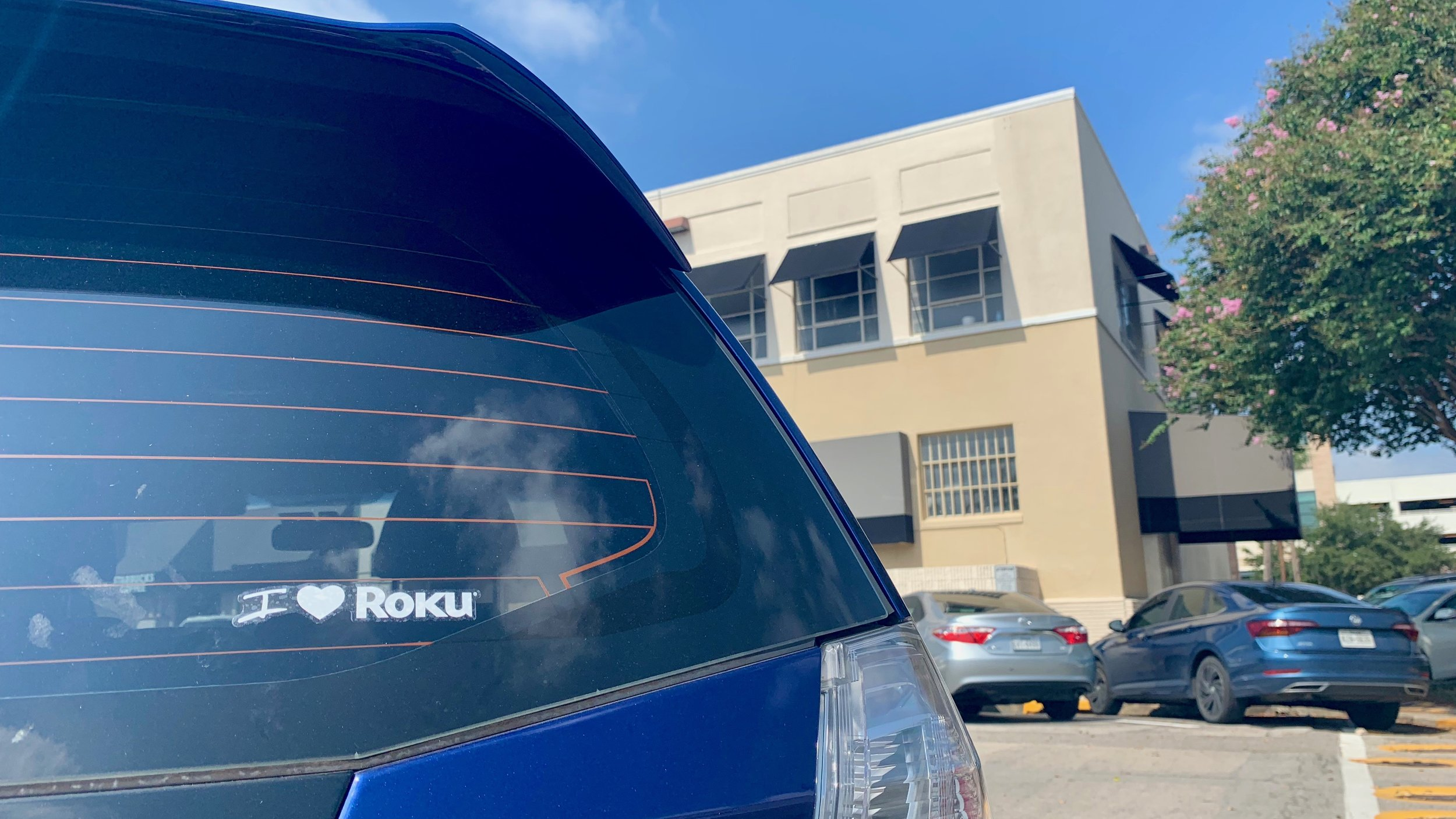 """This is the second Roku sticker I put on Katy's car. She removed the first one and blamed the people at the car wash, so I put a new one on her nice clean car. When I got this sticker with my Roku stick, I thought """"I really like Roku, but I would never put a Roku sticker on anything."""" Anything—except for Katy's car for this photo."""