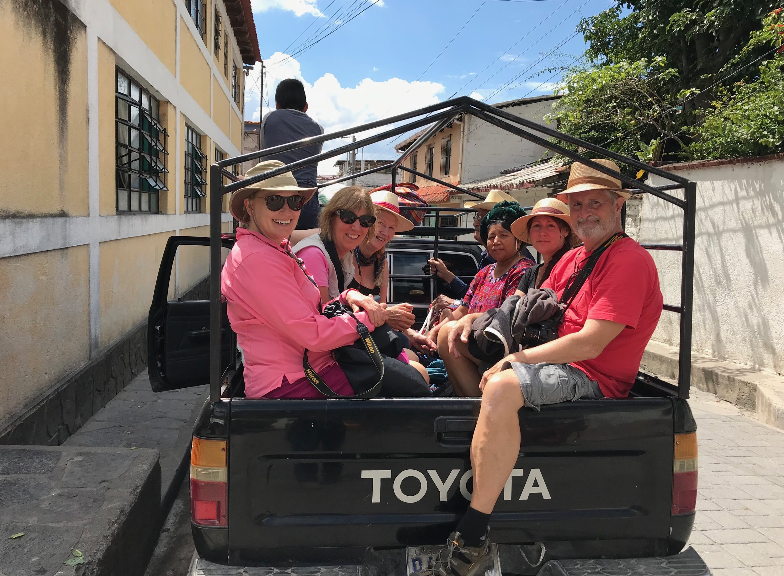 We usually travel in a mini van or taxis. (this is a truck we took to a small village)
