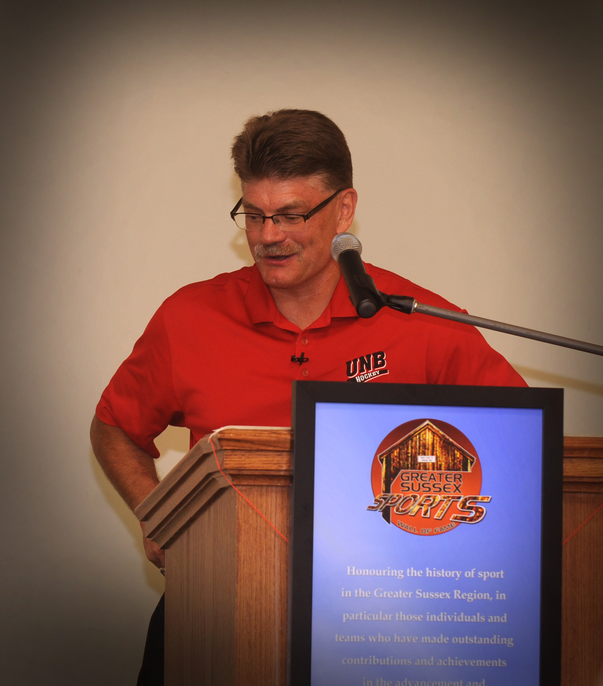 UNB Head Coach Gardiner MacDougall speaks at Wall of Fame ceremony