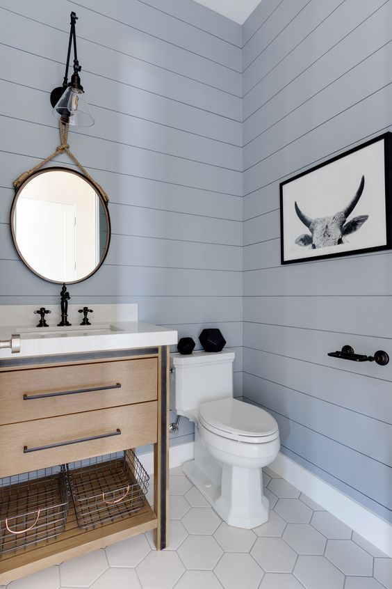 A small powder room is light and airy in—what else? Powder blue. Image via DigsDigs .